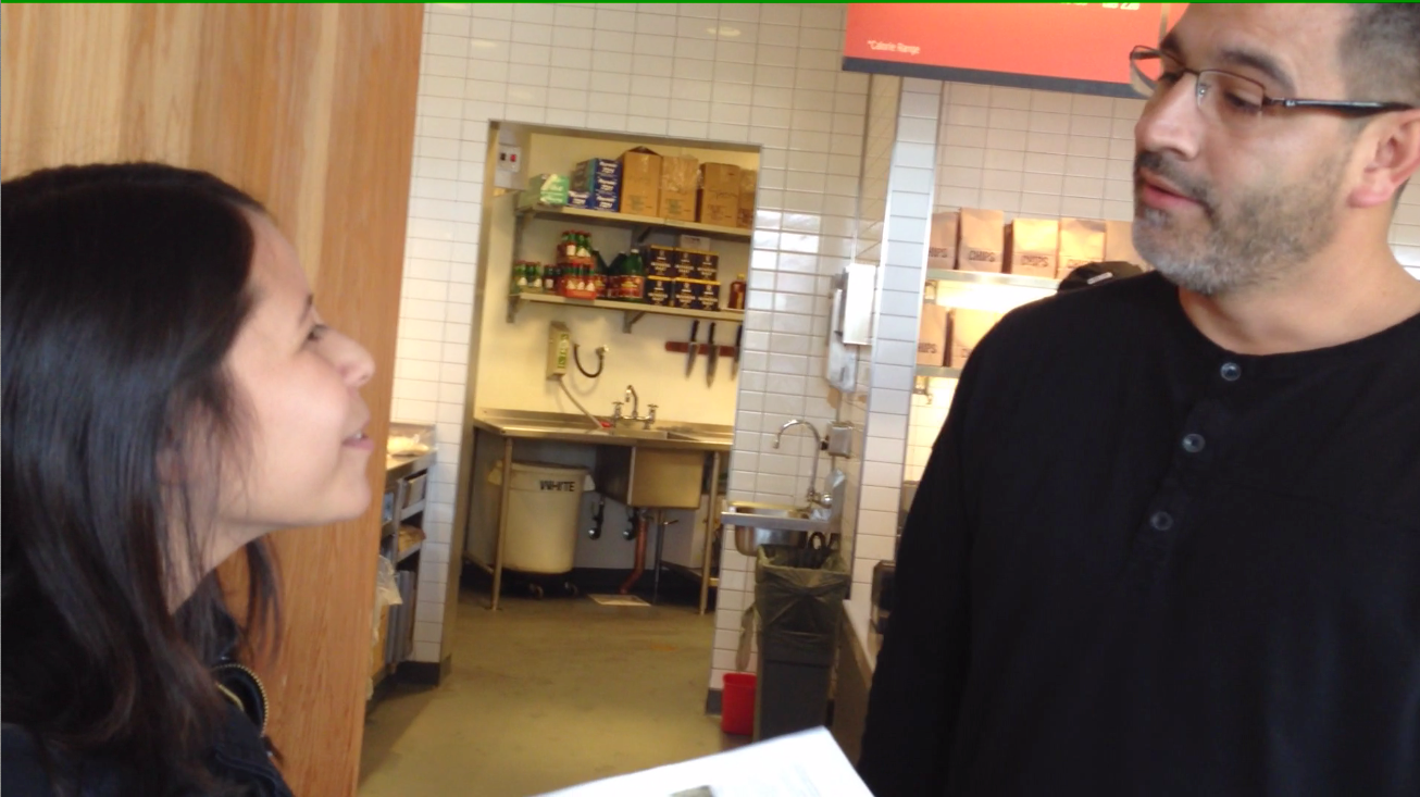 The manager confronts an activist in Santa Cruz, immediately upon entering the restaurant.