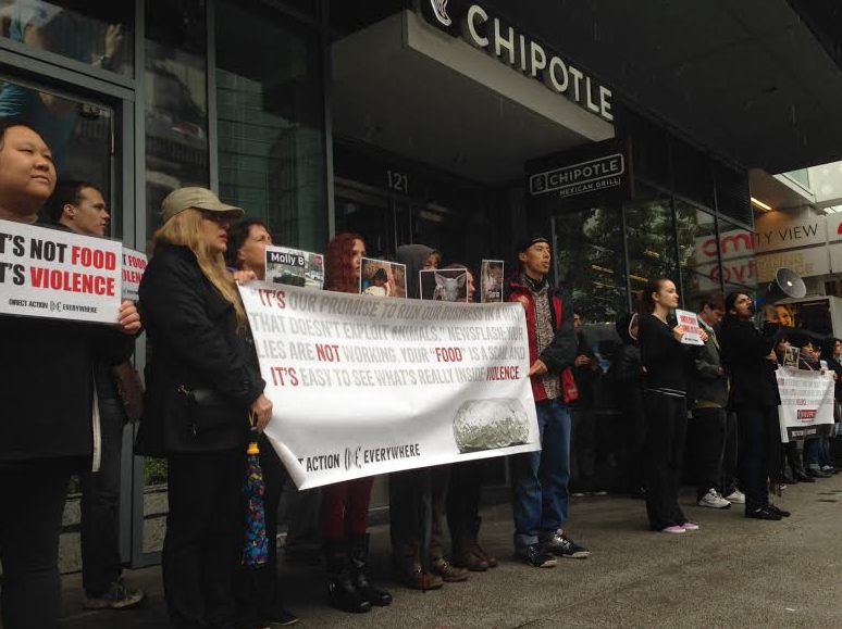 Protesters in San Francisco stood in the rain, in front of a closed Chipotle, to protest the industry's violence and lies.