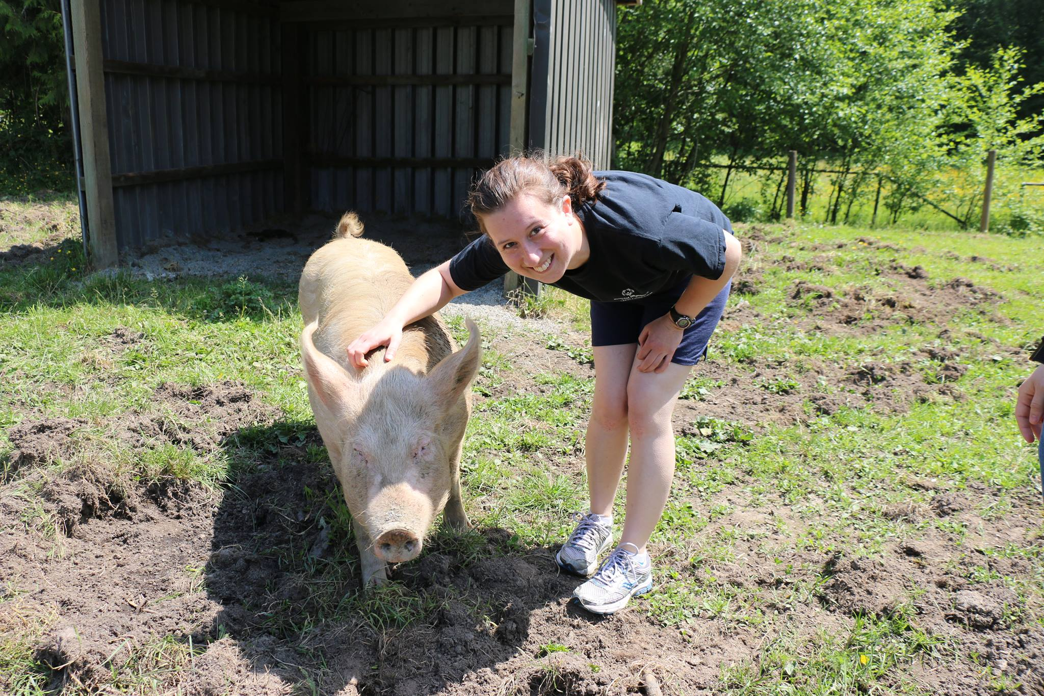Almira with Lucy, a rescued pig, at The Happy Herd sanctuary.