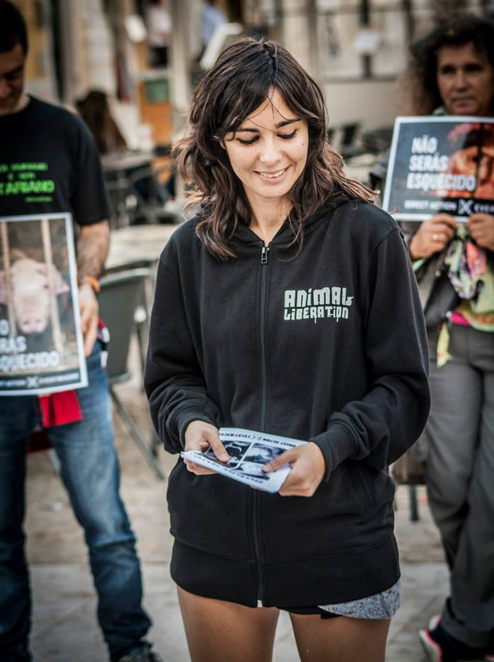Andreia Carvalho Mota participating in Disrupt Speciesism, DxE's September 2014 Day of Action, in front of a McDonald's in Lisbon, Portugal.