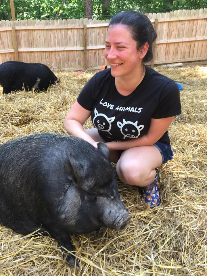 Arwen playing with a pig!