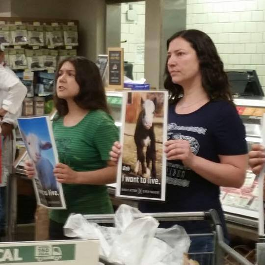 Arwen, along with co-organizer Maria-Adriana Rojas, protests inside of a Whole Foods