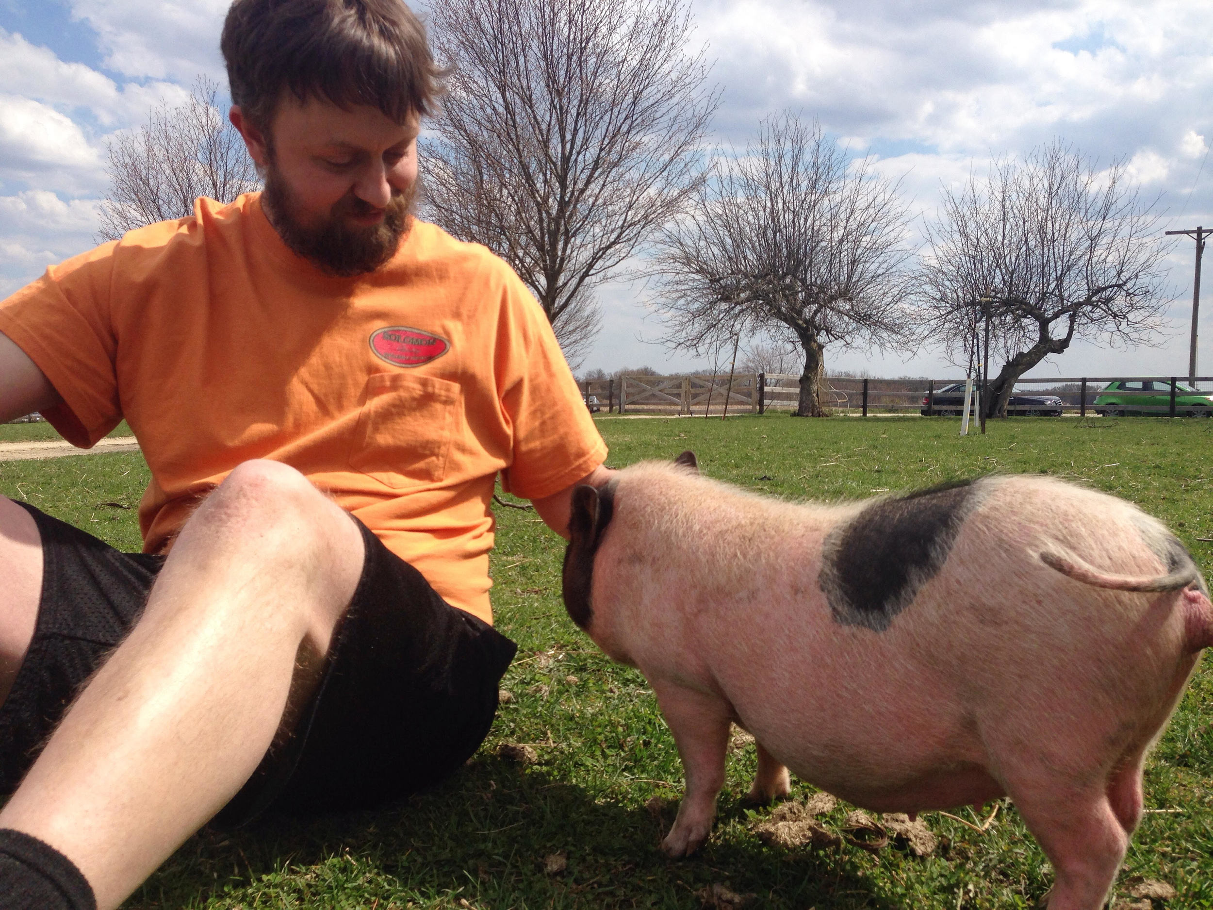 Paul hanging out with a pig