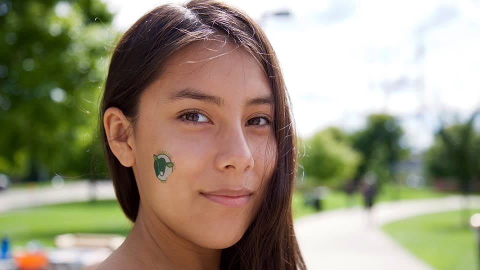 Ana's face adorned with an animal rights tattoo