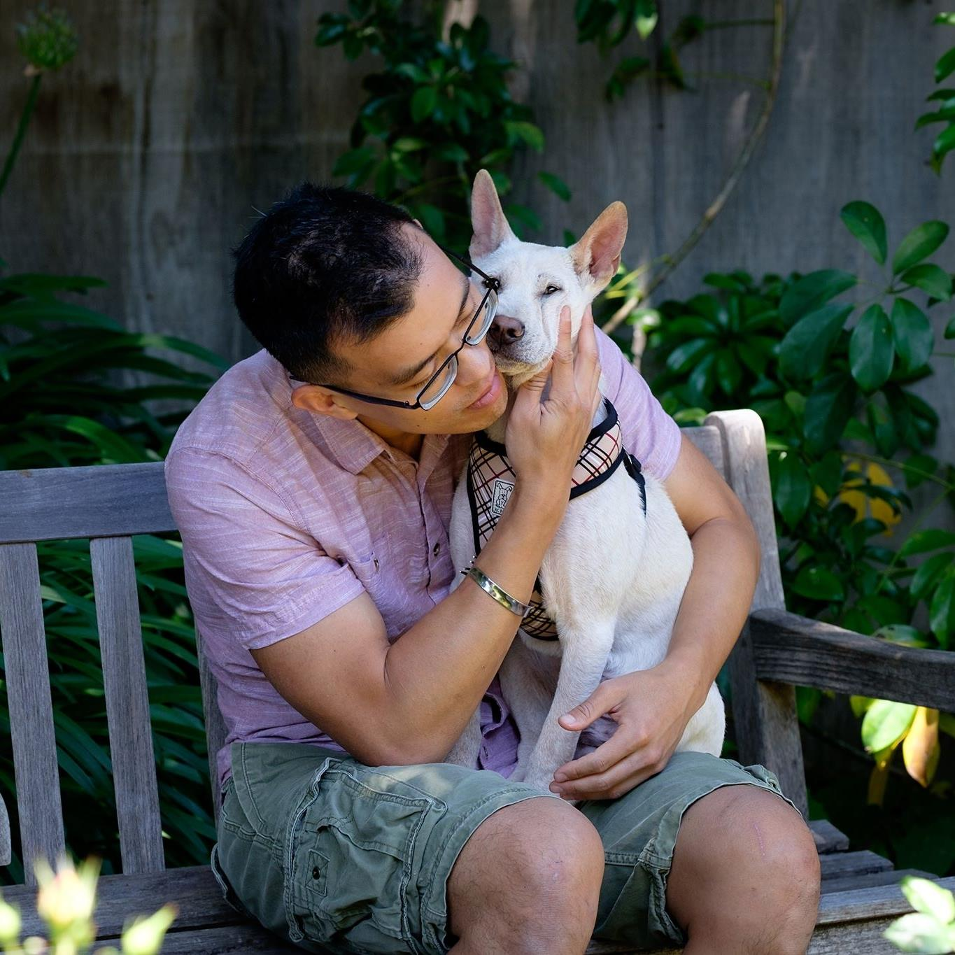 Rescuer Wayne Hsiung with Oliver, a dog  rescued from a farm in Yulin, China .