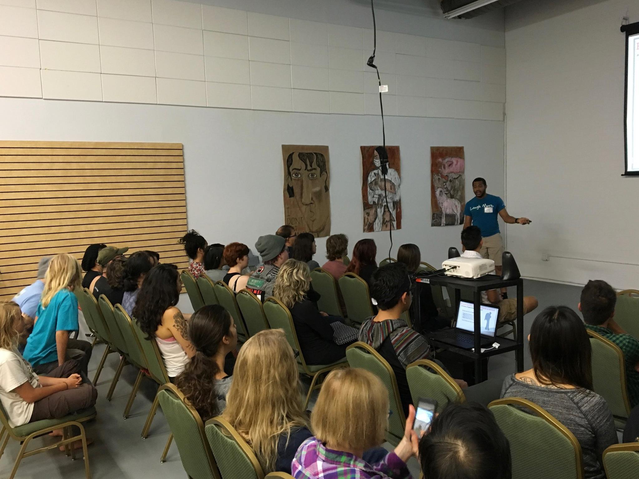 Community members participate in a public speaking seminar.