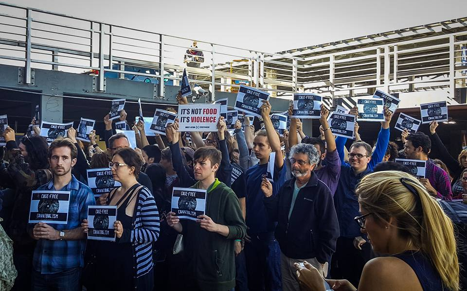 DxE activists protest outside Costco in San Francisco.