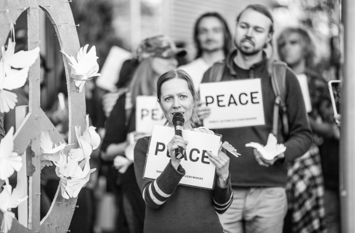 Activists demand peace outside a grocery store