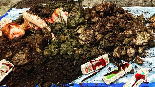 Vegan activist covers herself in animal dung outside a Trader Joe's to protest the chain's alleged manure-filled living conditions for hens - March 22, 2018Daily Mail