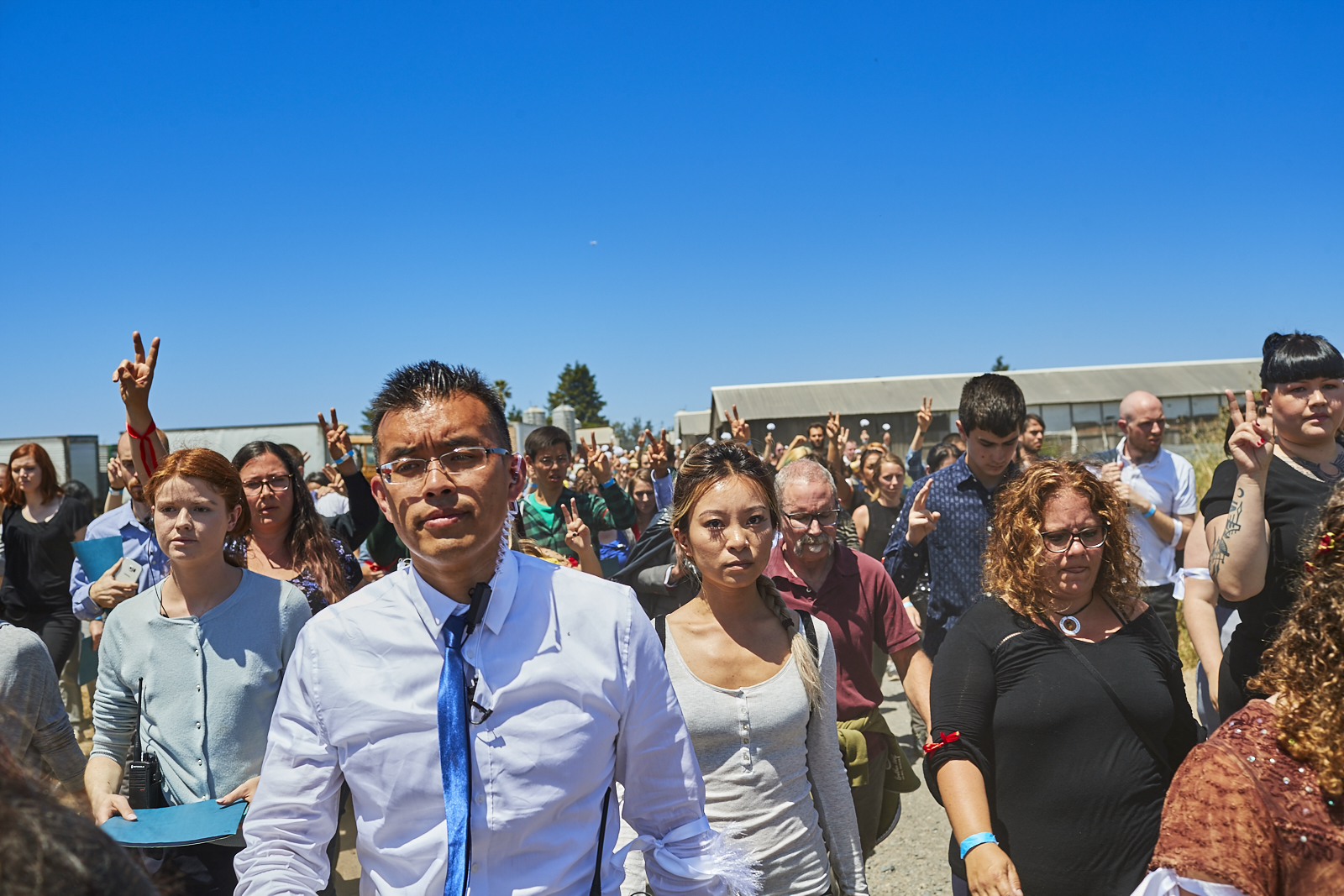 DxE activists led by Wayne Hsiung at mass open rescue on Petaluma farm in late May. Photo by Michael Goldberg