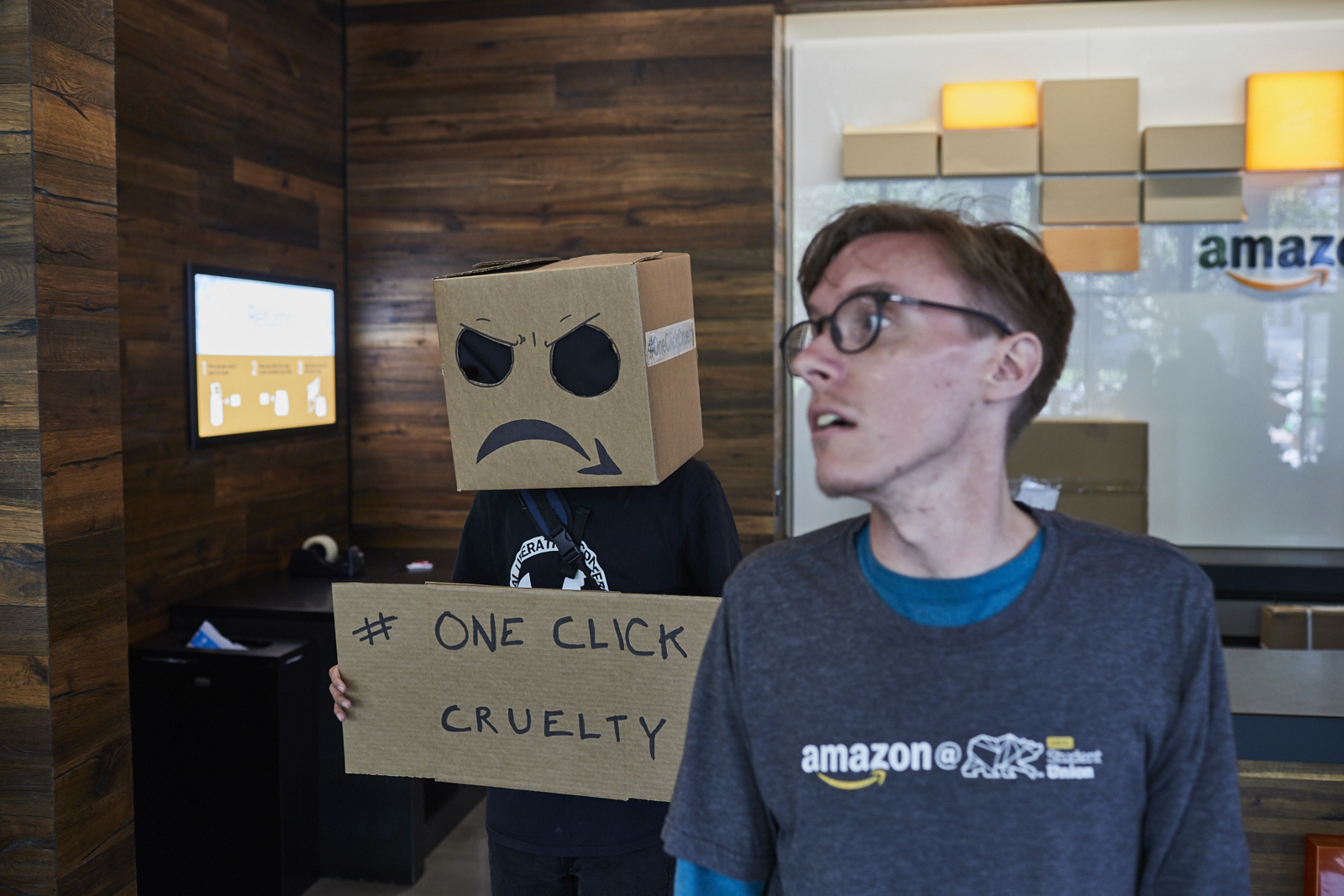 """""""Amazon Creeper"""" inside Amazon store on UC Berkeley campus with store manager."""