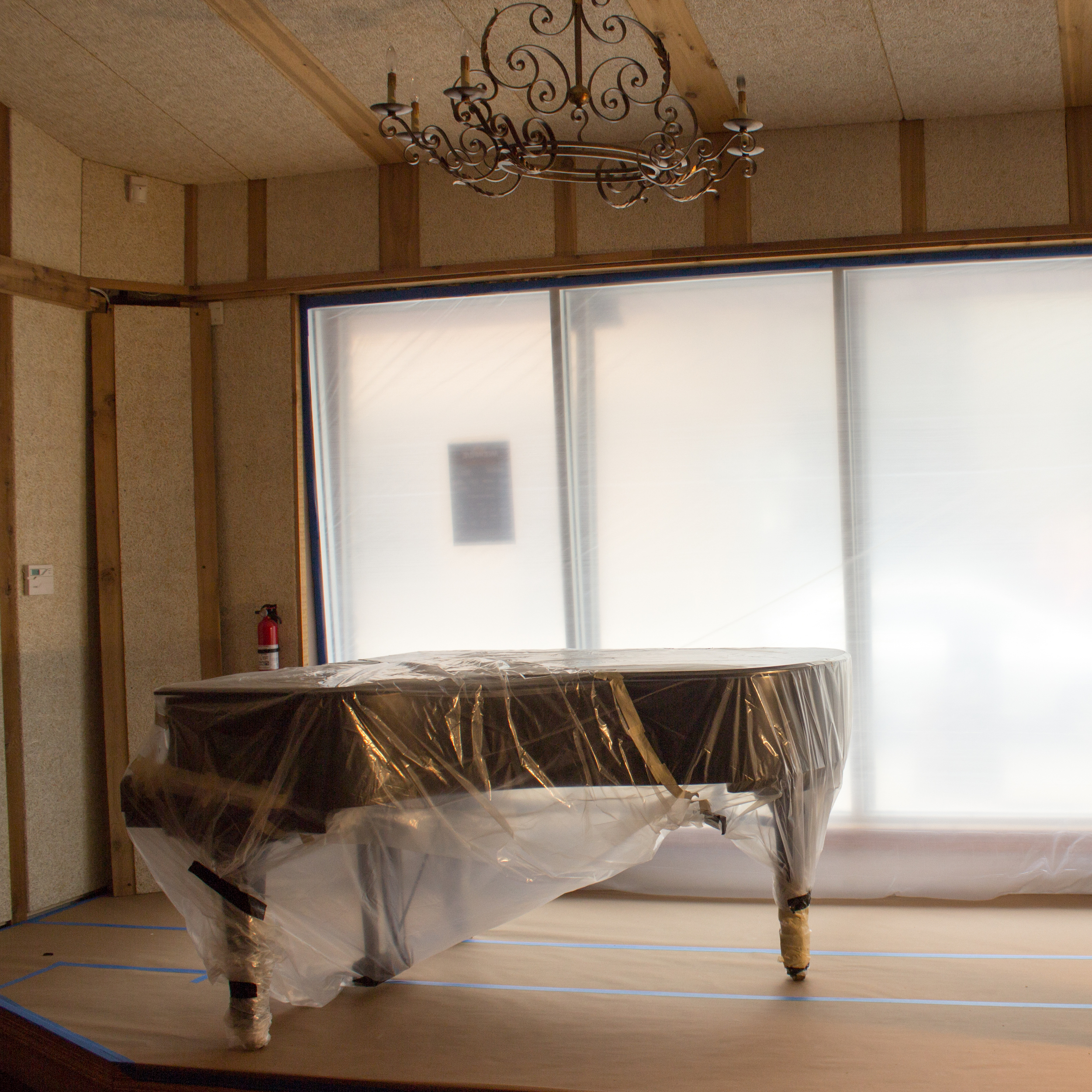 Studio grand is wrappedair-tight and ready to take on some serious dust.
