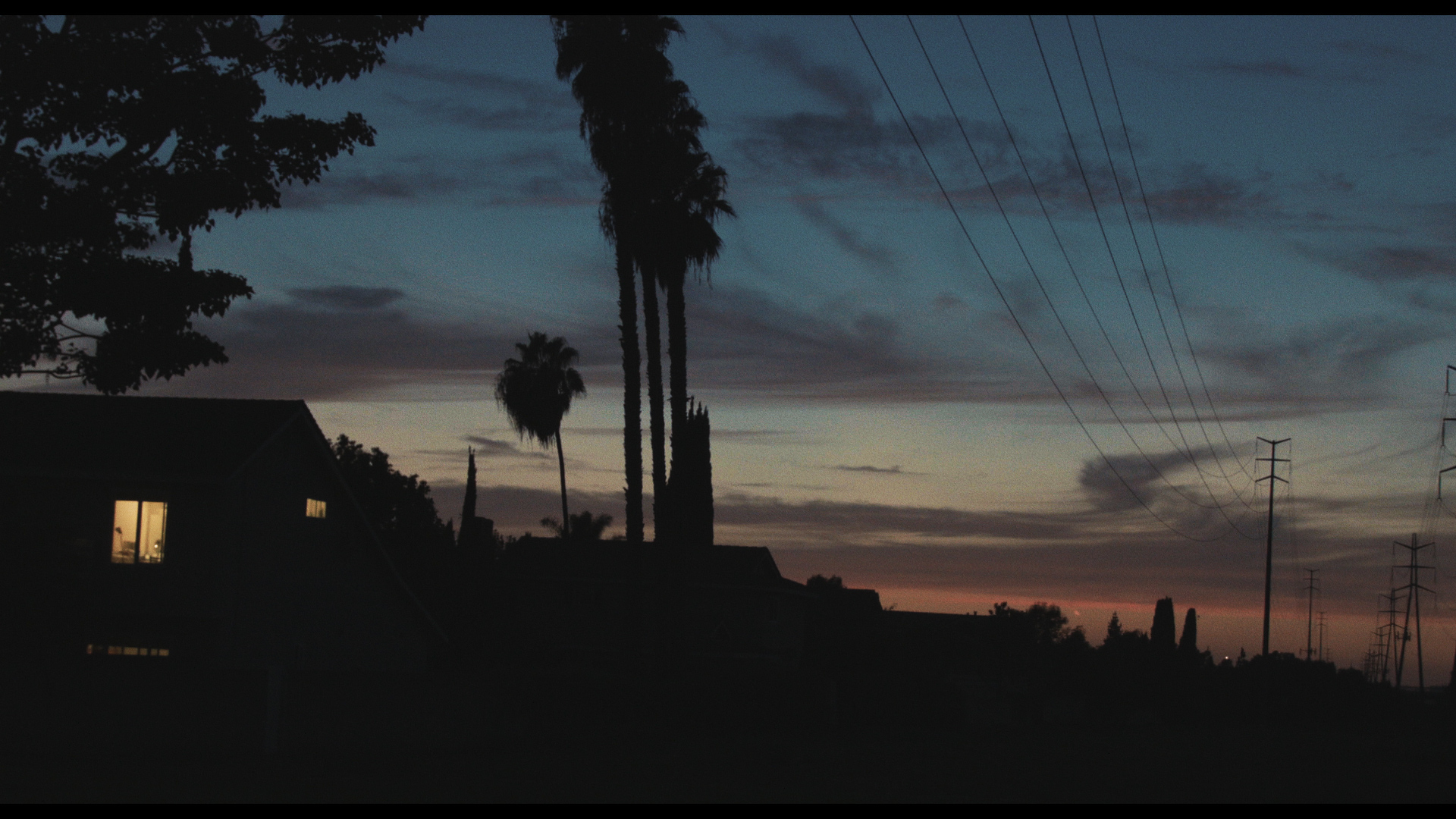Still from Three Worlds. Suburban Landscape