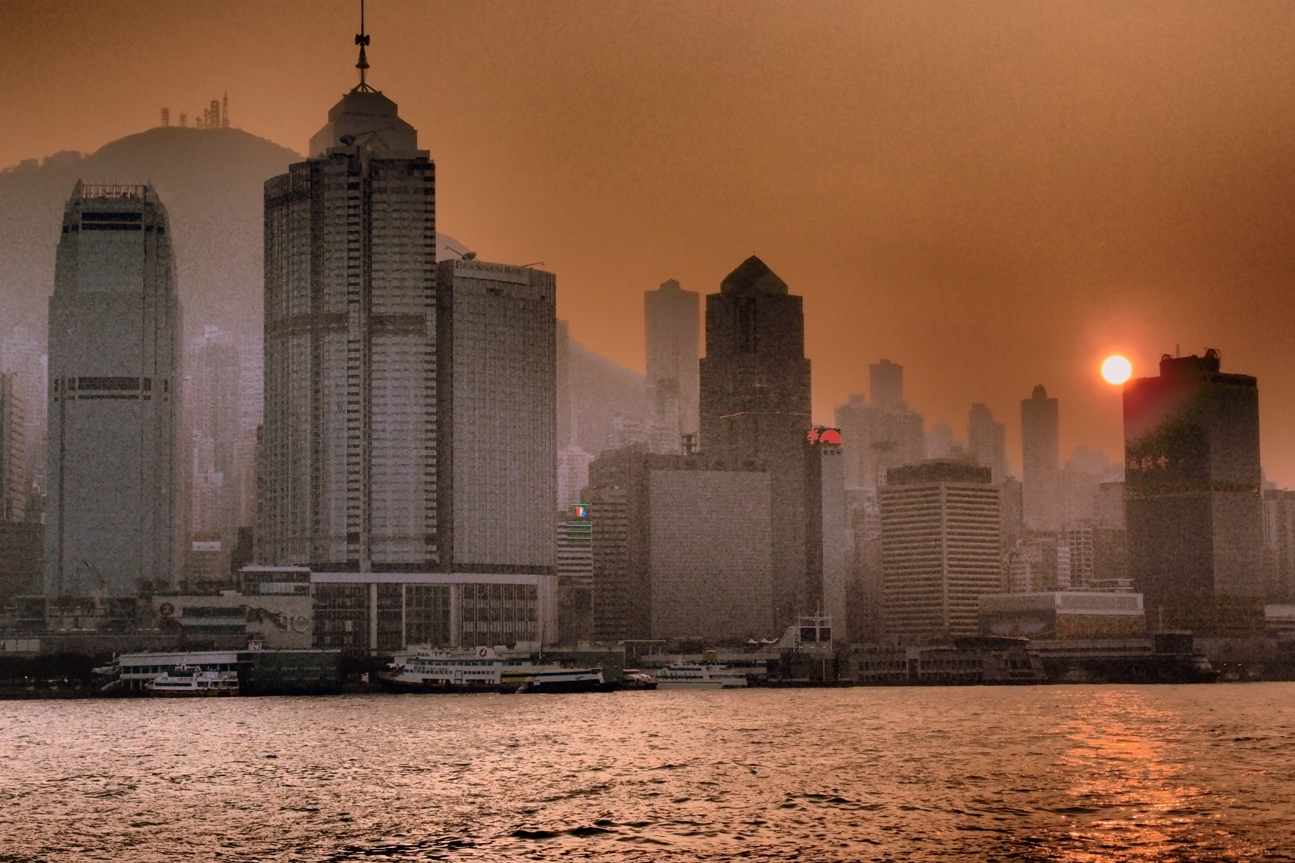 A hazy, foggy, polluted winter sunset in Hong Kong
