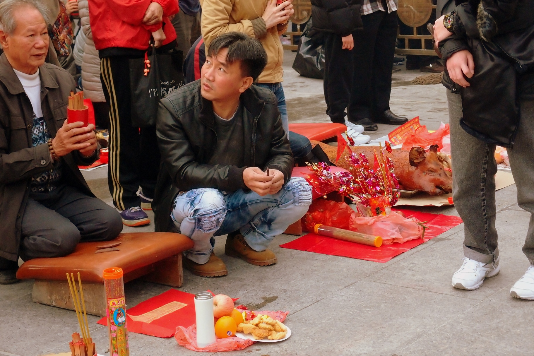 Shaking the chim (fortune sticks) at the Sik Sik Yuen Wong Tai Sin Temple