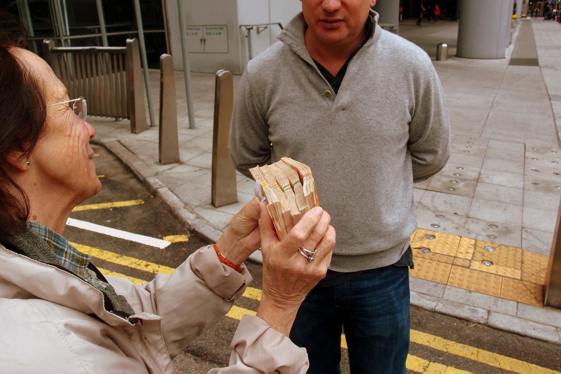 A slightly drunk expat jigs in the street with his winnings on the horses...