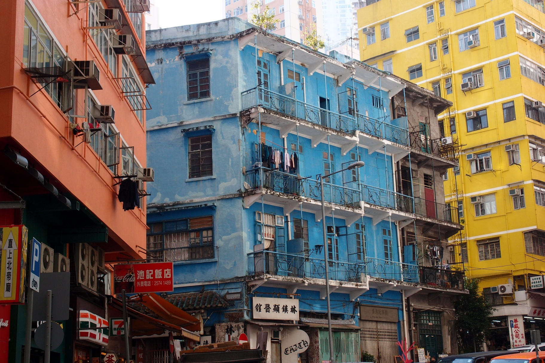 The Blue House located at Stone Nullah Lane in Wanchai and legend has it the families living in there use buckets as toilets and pay an old codger to remove the waste every day!