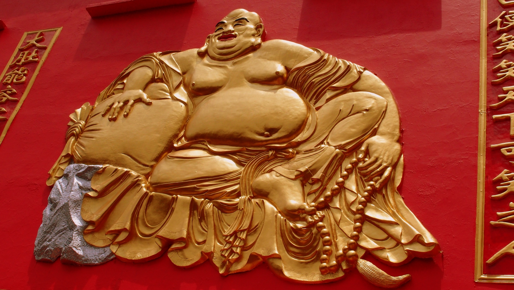 This is the jolly fat buddha at the Ten Thousand Buddha Monastery in Shatin, he hides a dark secret