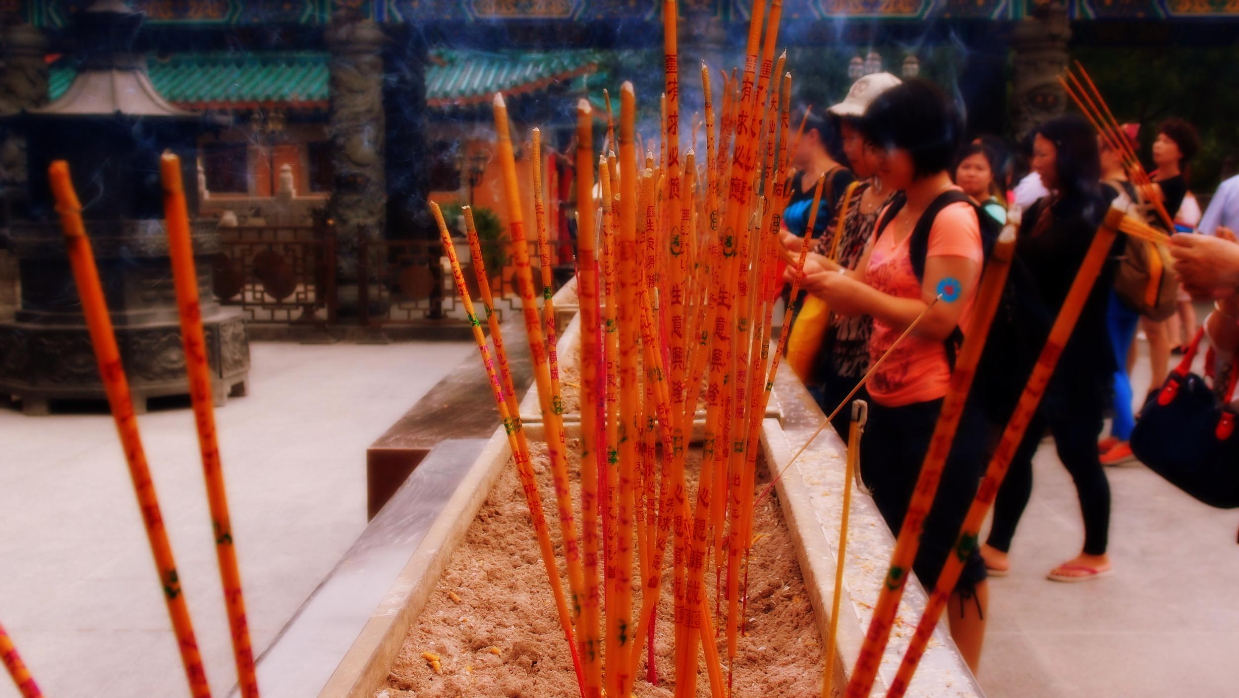 A spot of incense burning at the Sik Sik Yuen Wong Tai Sin Temple