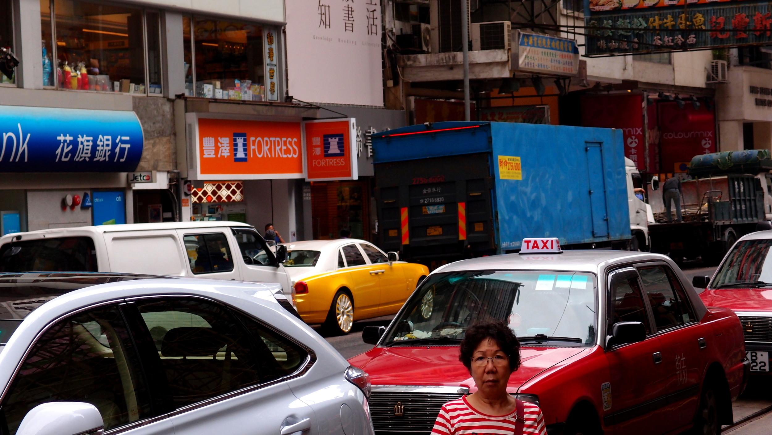 My favourite Rolls Royce lurking in a dodgy looking street in Wanchai