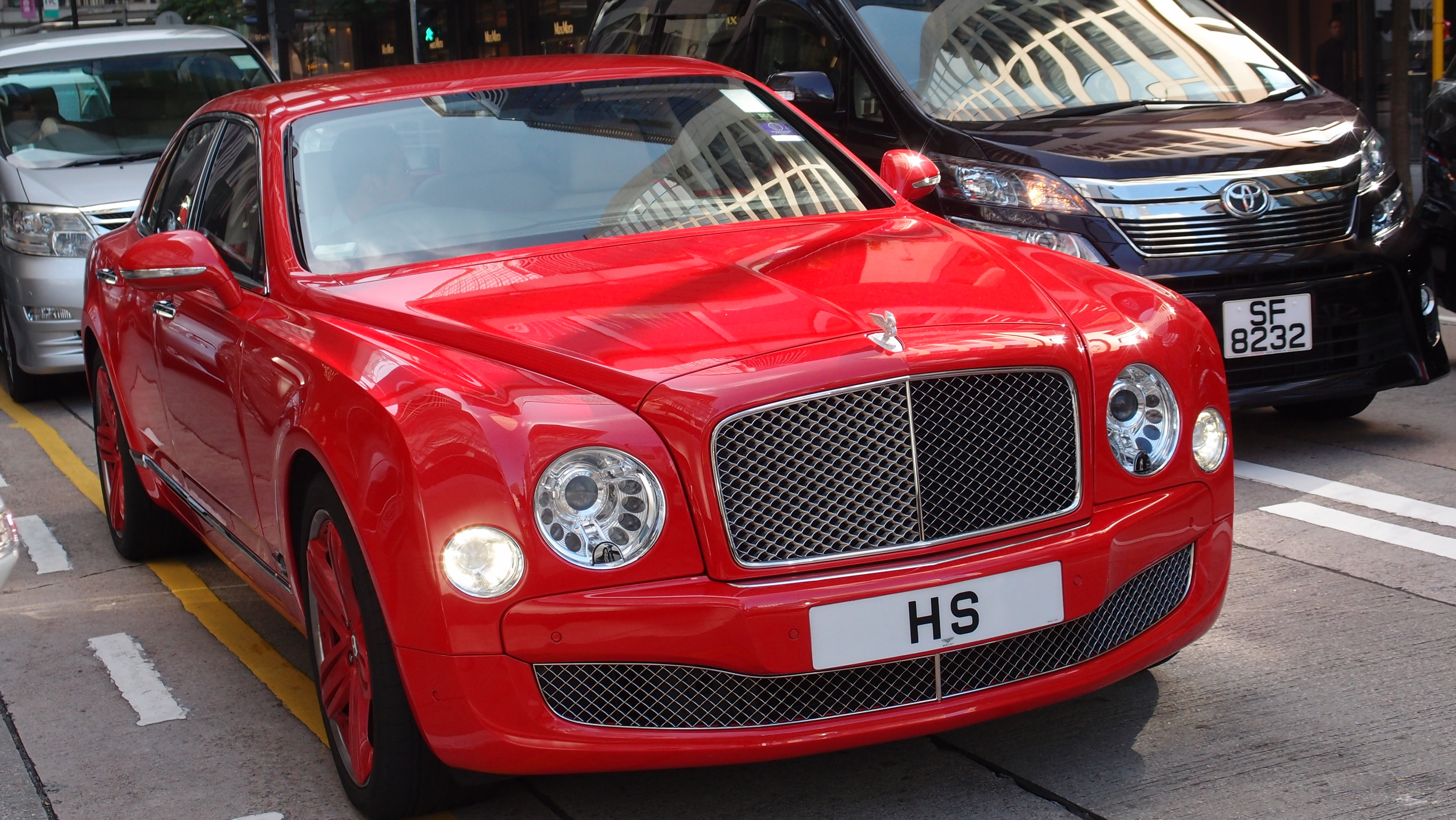 The magnificent shimmering red Bentley