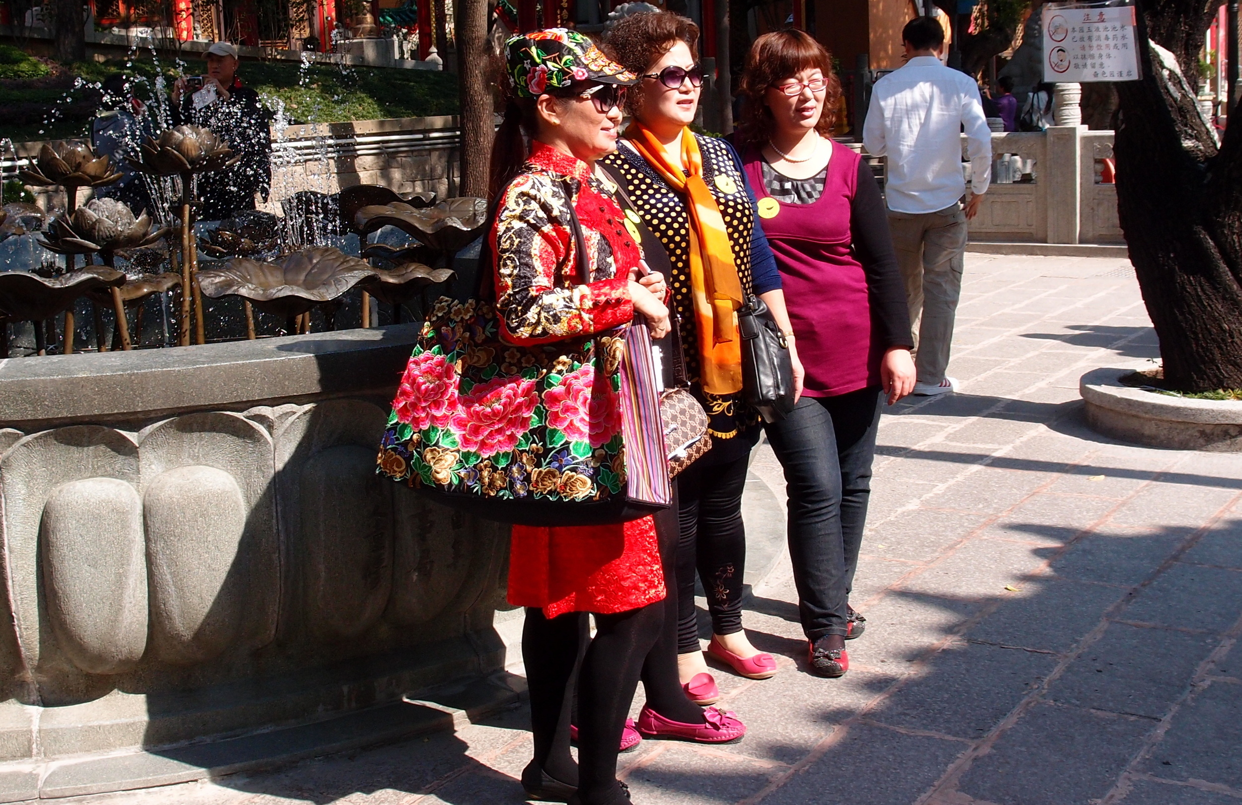 Very colourful Mainland Chinese tourists at the Sik Sik Yuen Wong Tai Sin Temple
