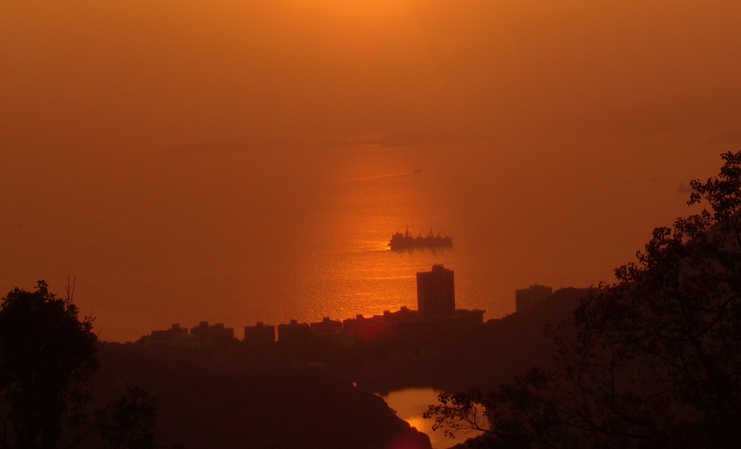 A glorious sunset at the Peak with Cheung Chau Island in the distance.