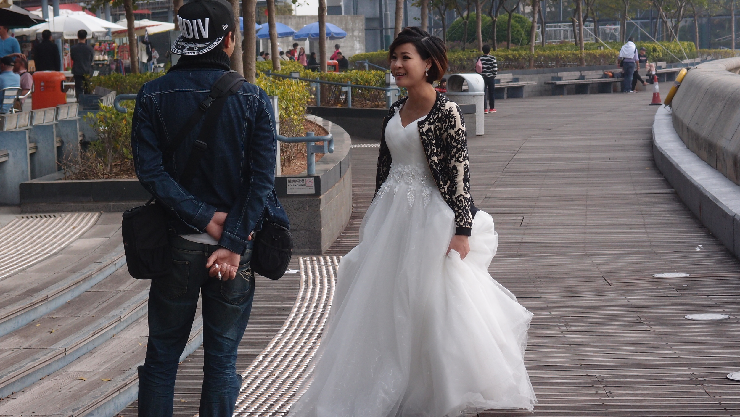 The happy bride to be discussing lighting issues on Stanley Promenade