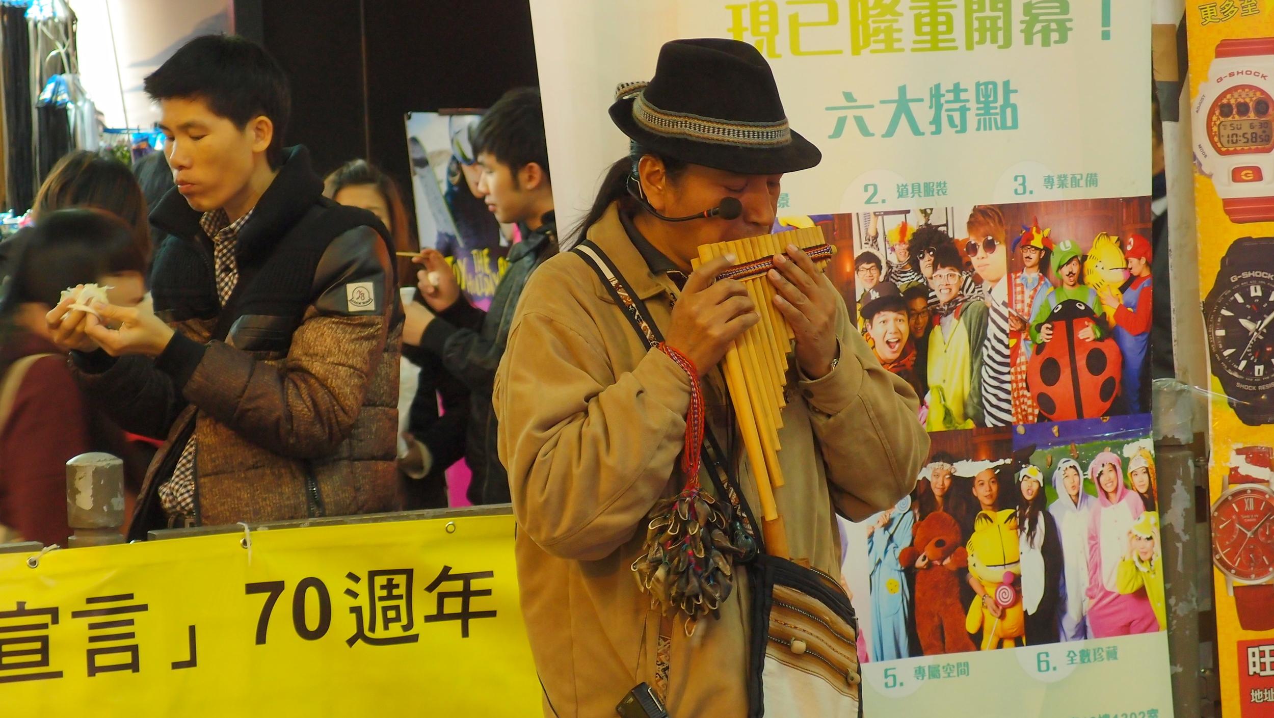 A one man Peruvian pipe band busking in Hong Kong