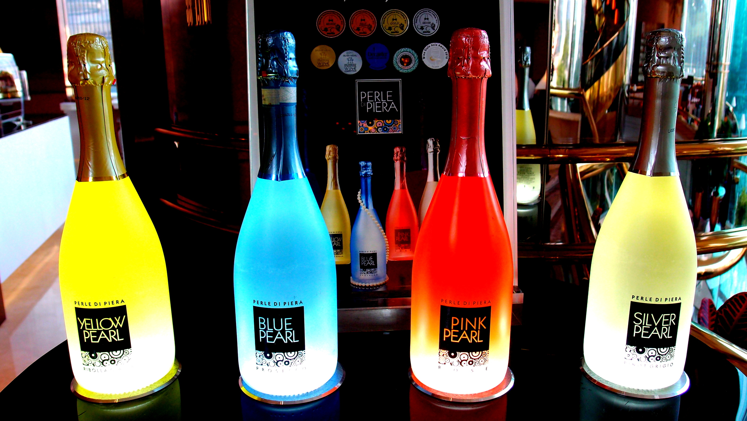 Bottles of stuff that presumably give you a hangover in glorious colour.