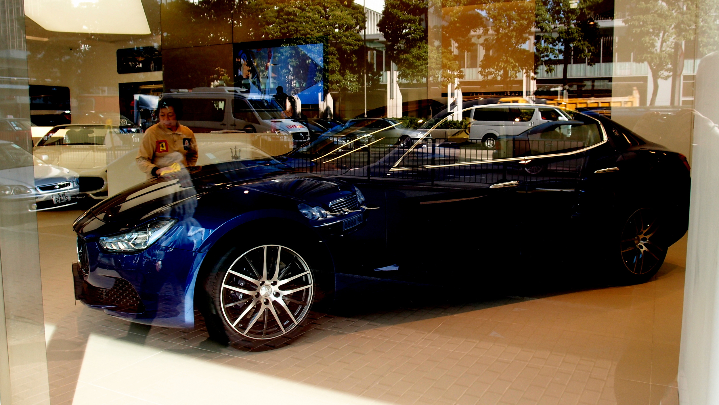 A Karate Kid moment, wax on, wax off... nice car by the way - I do love Maserati's.