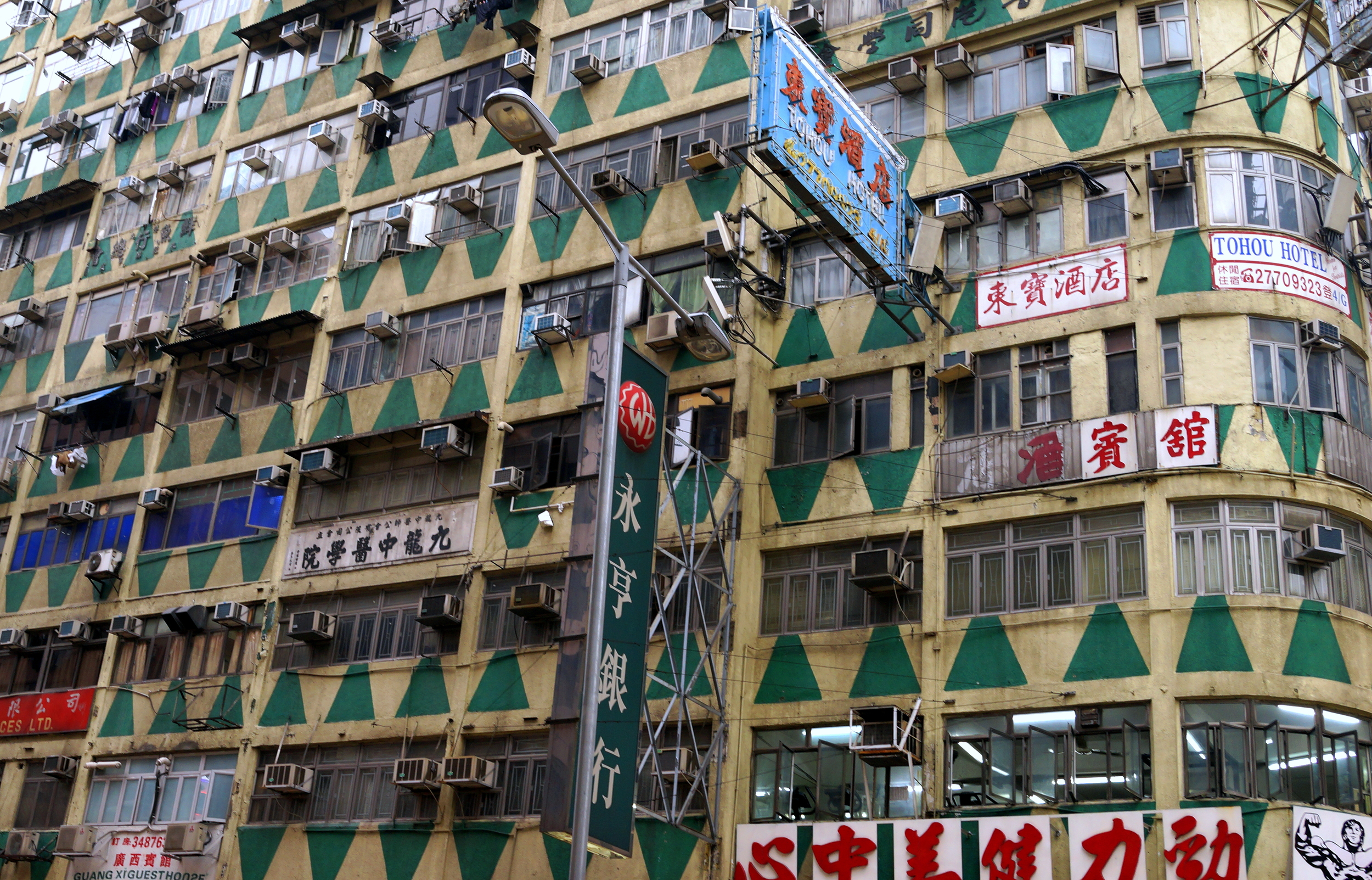 They don't make buildings like this anymore, this one is located at the junction of Nathan Road and Jordan Road in Kowloon. Vintage 1960's.