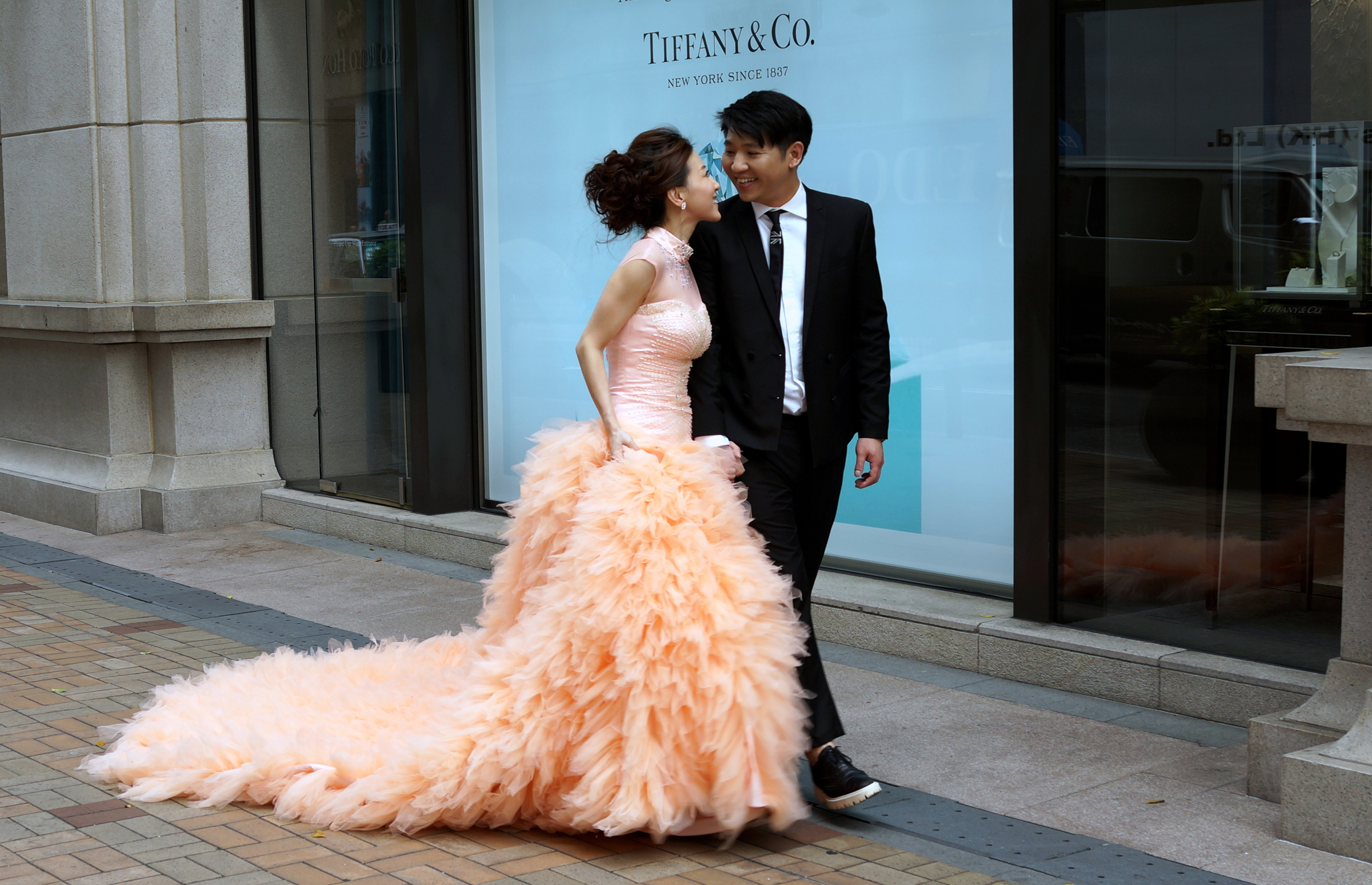 Isn't that just a lovely wedding dress! The pre - wedding photography outside Tiffany at 1881 Heritage in TST, Kowloon