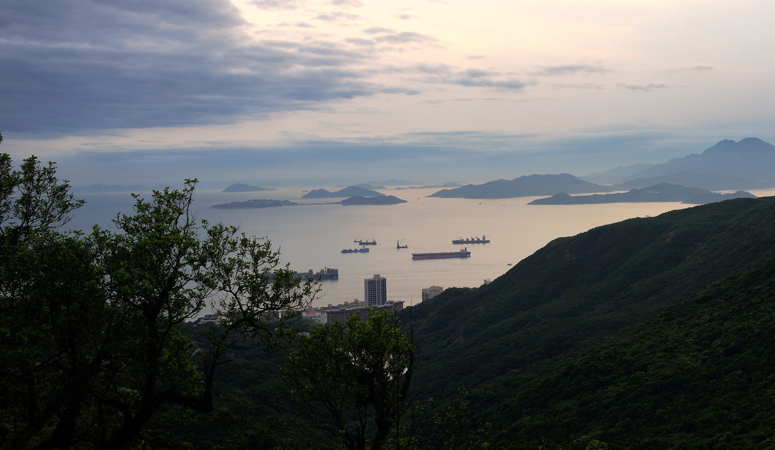 April 26th 2014 was cloudy but very clear - it is quite rare to see Cheung Chau Island (2 humps joined by a thin strip) and the other islands from the Peak.