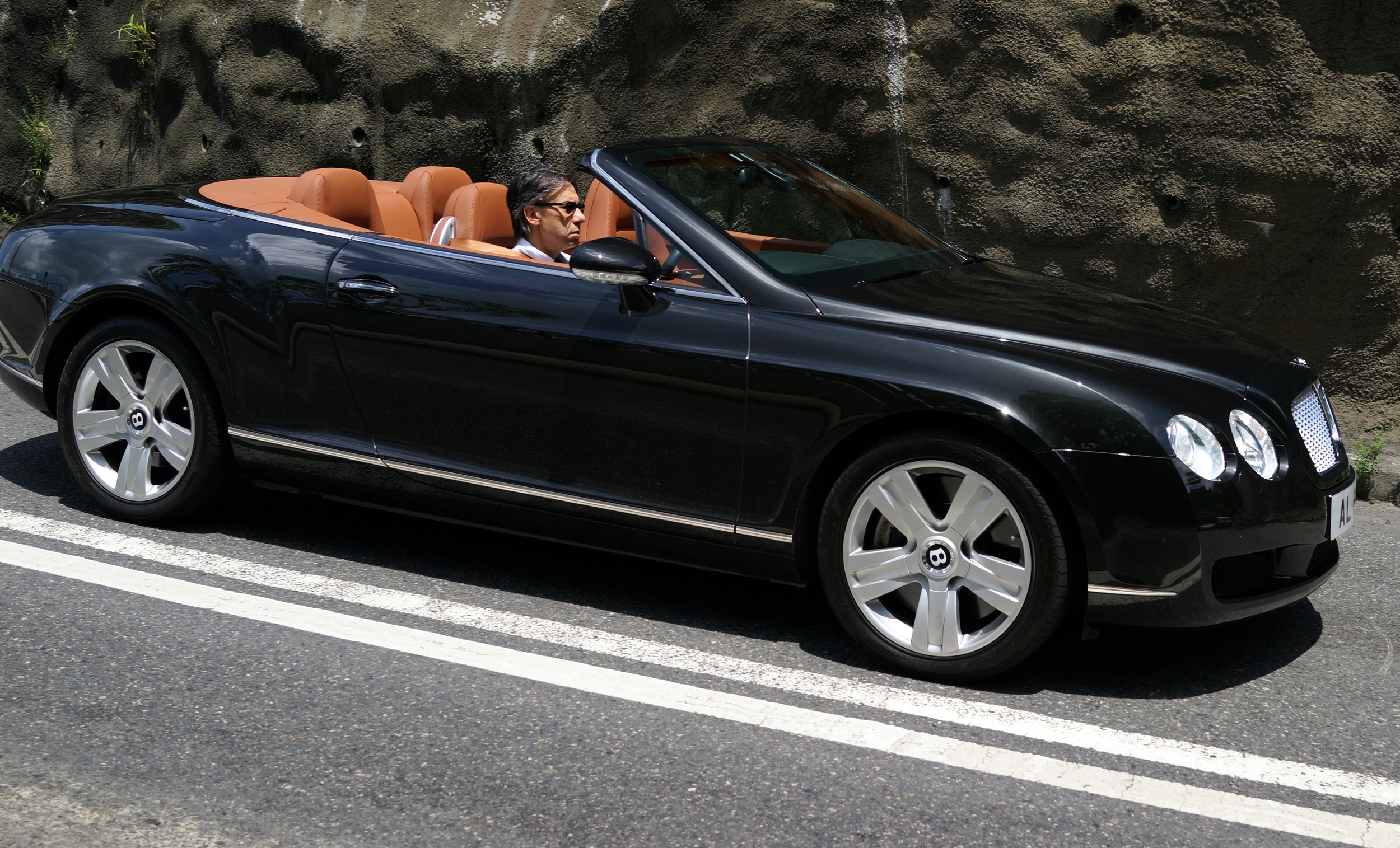 Mid morning on a sunny Sunday zipping through the very scenic Deep Water Bay in a Bentley, I would be grinning from ear to ear... miserable sod!
