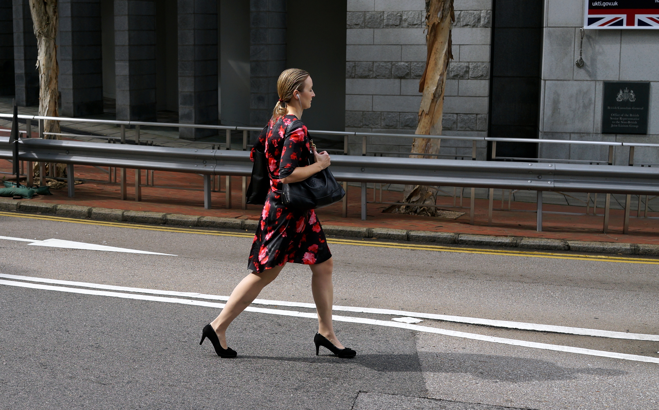 Elegant lady crossing the street near the British Consulate on Justice Drive at Admiralty..