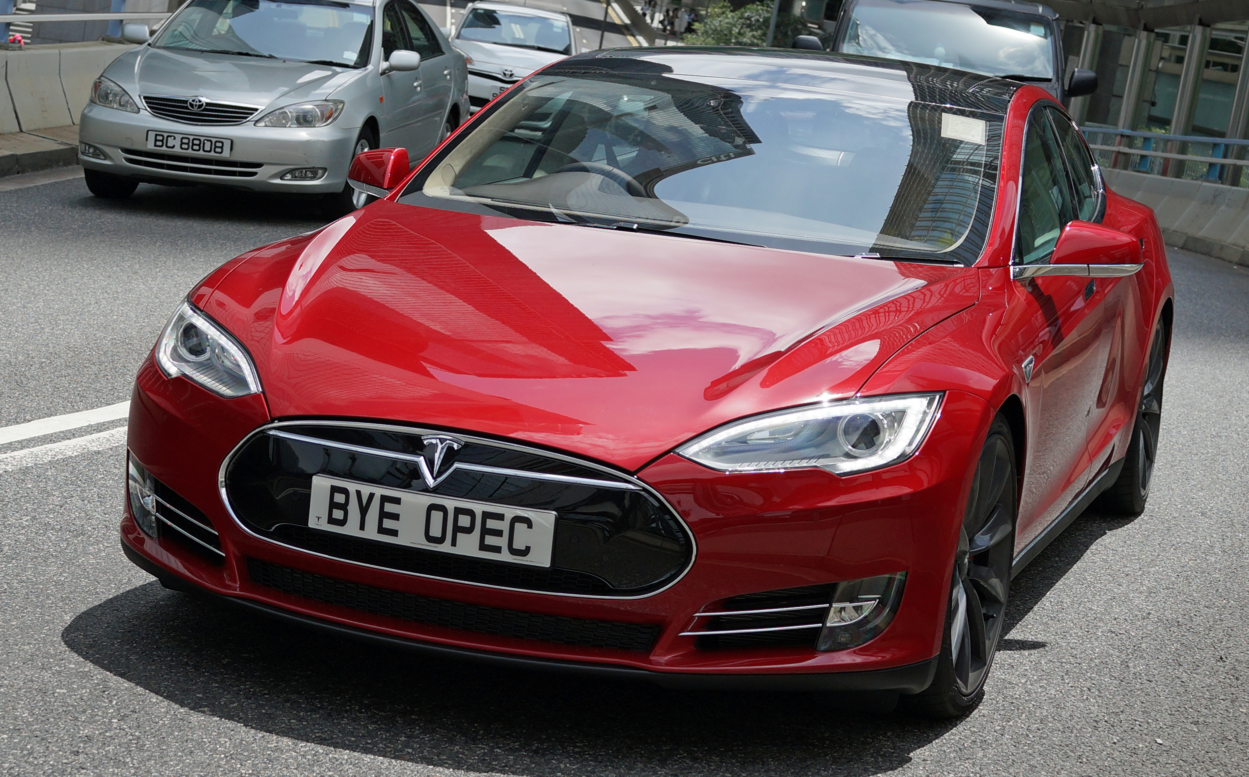 I admit that at first I was not a fan of the Tesla but I have to admit that it is growing on me - I have pretty much photographed every Tesla Car in Hong Kong ... as you can see it has a rather striking profile and I love this guys sense of humour with the number plate!!
