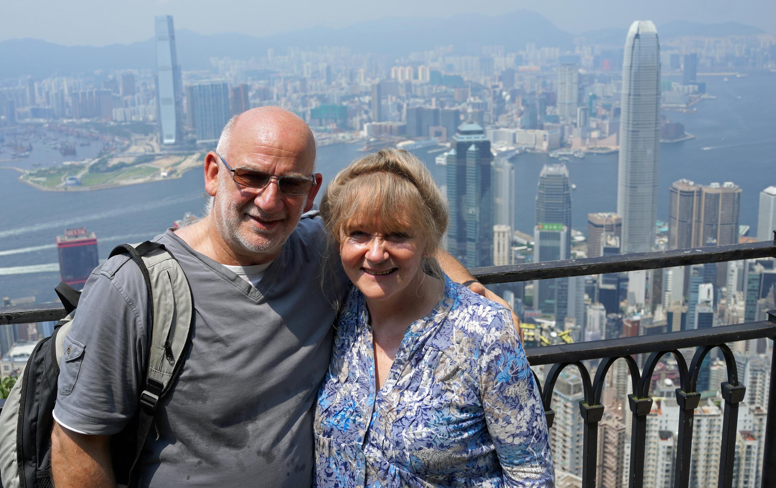 Meet Jill an eminent Doctor and Allan an eminent Artist from Scotland enjoying the brilliant views from my spot at Victoria Peak.