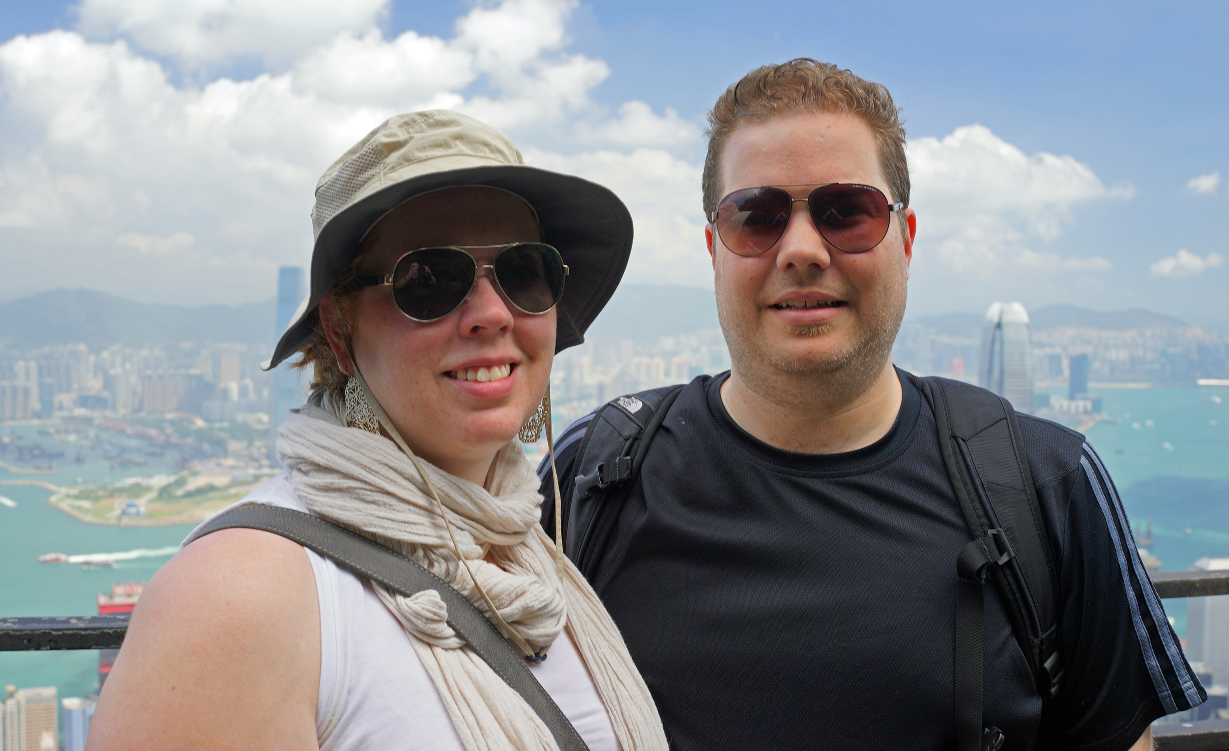 Andrea and David, just married, from Canada - enjoying the magnificent view of Hong Kong from my spot at Victoria Peak.