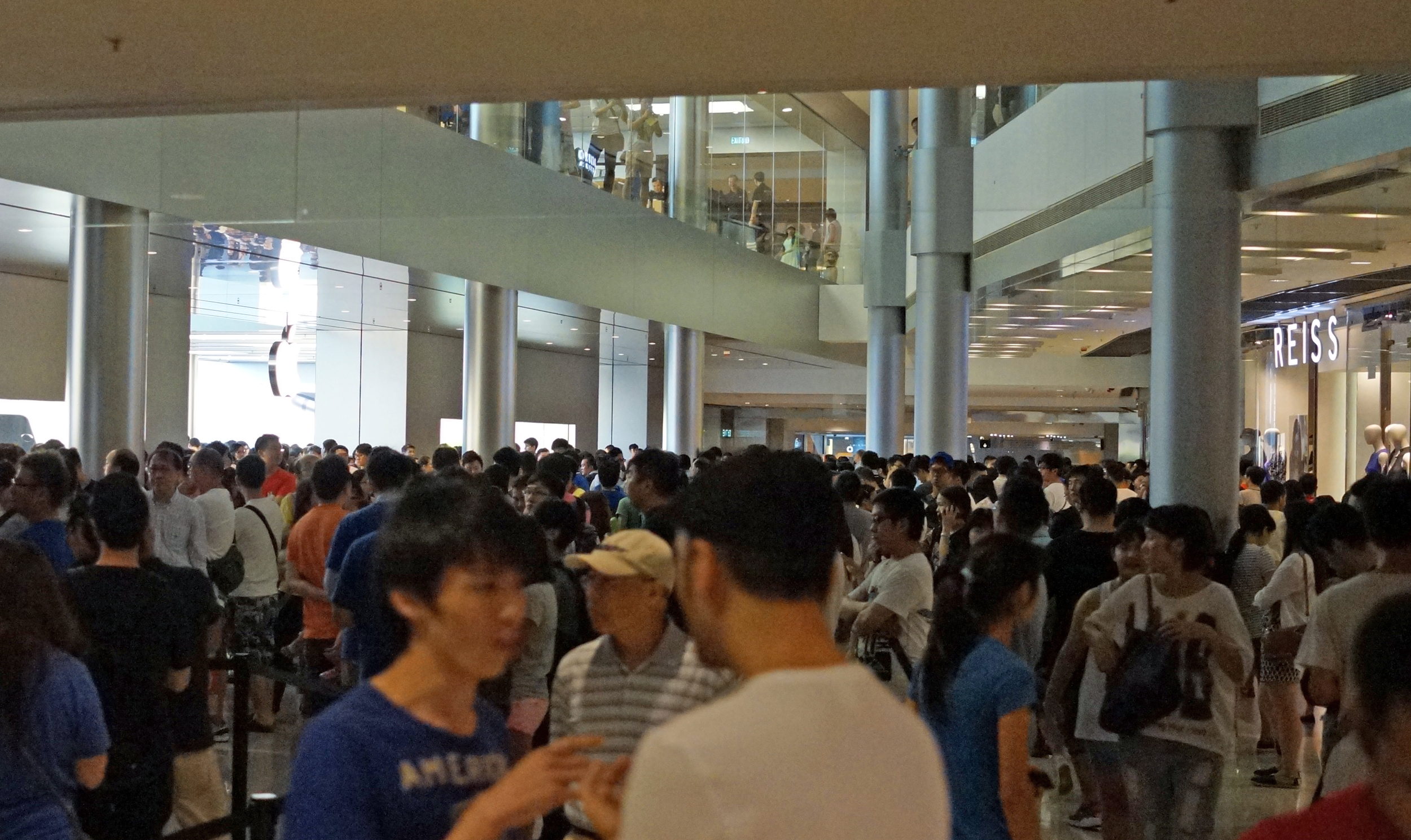 About 800 people lining up inside and outside the Apple Store at IFC Mall in Central, Hong Kong - waiting to take delivery of the new IPhone 6