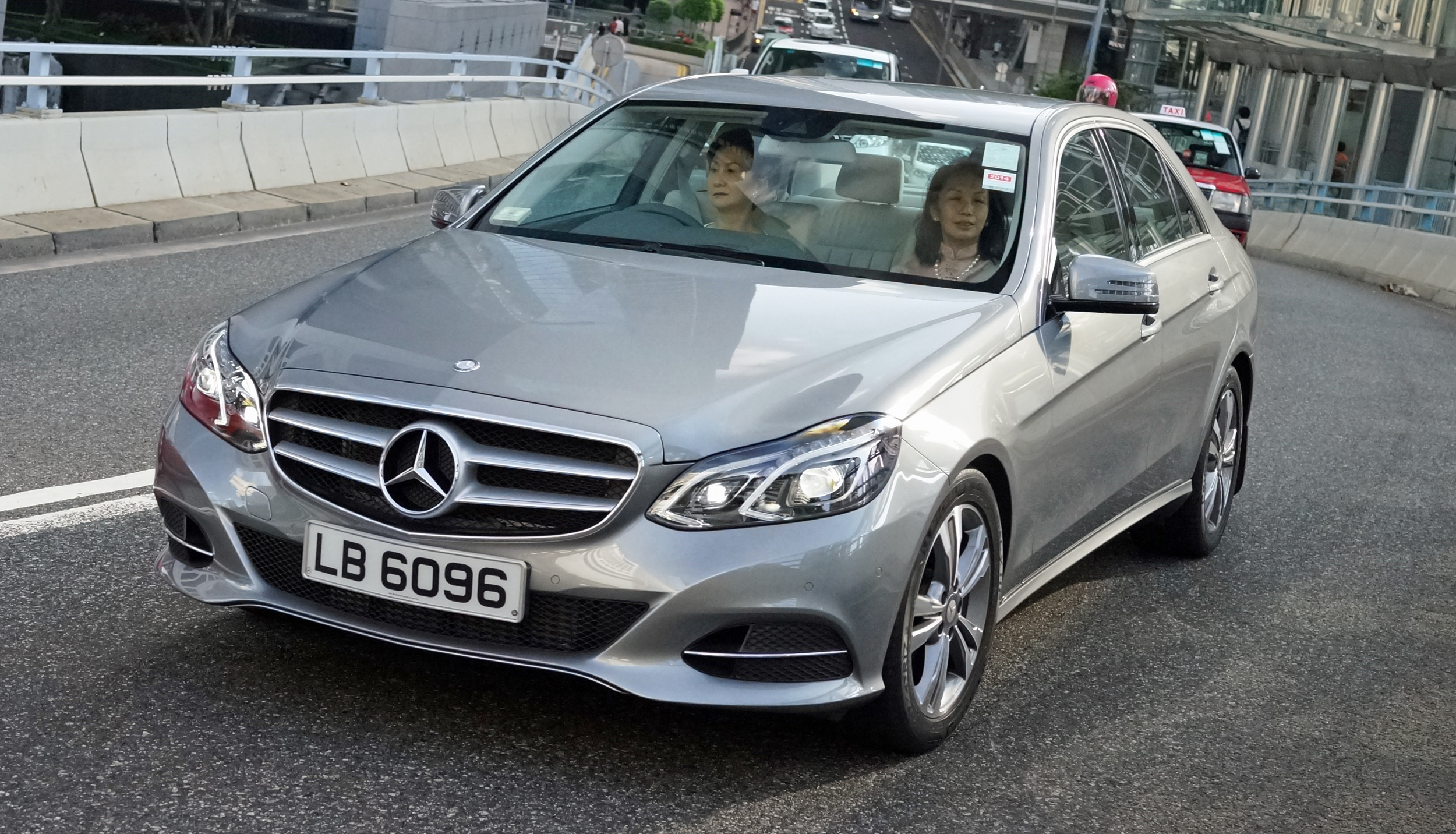 This is the more typical Hong Kong lady in the car (so to speak) they do look rather posh and refined and this model Mercedes is for them probably the family runabout!