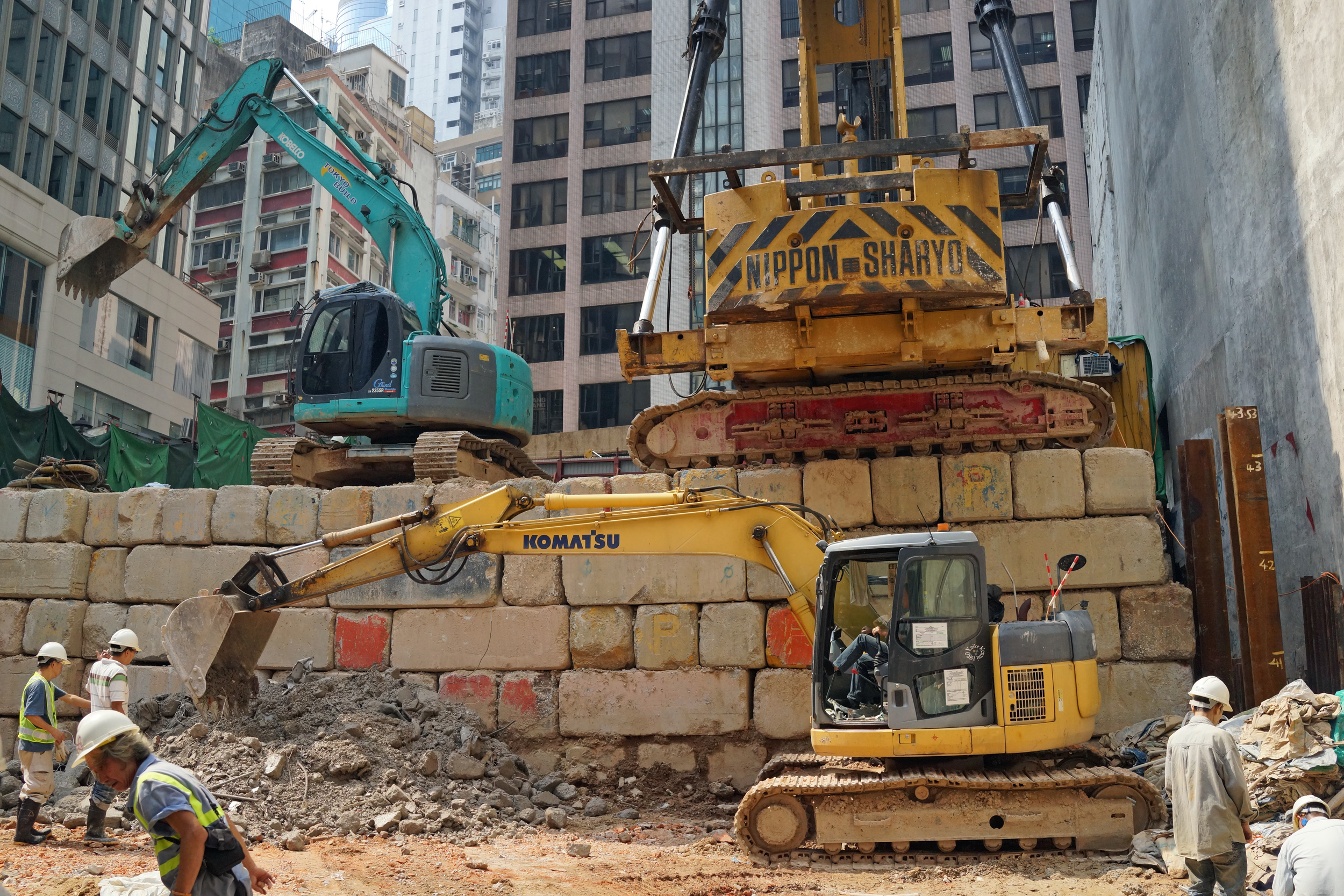A monster pile driver on some monster bricks at a building site in Central District