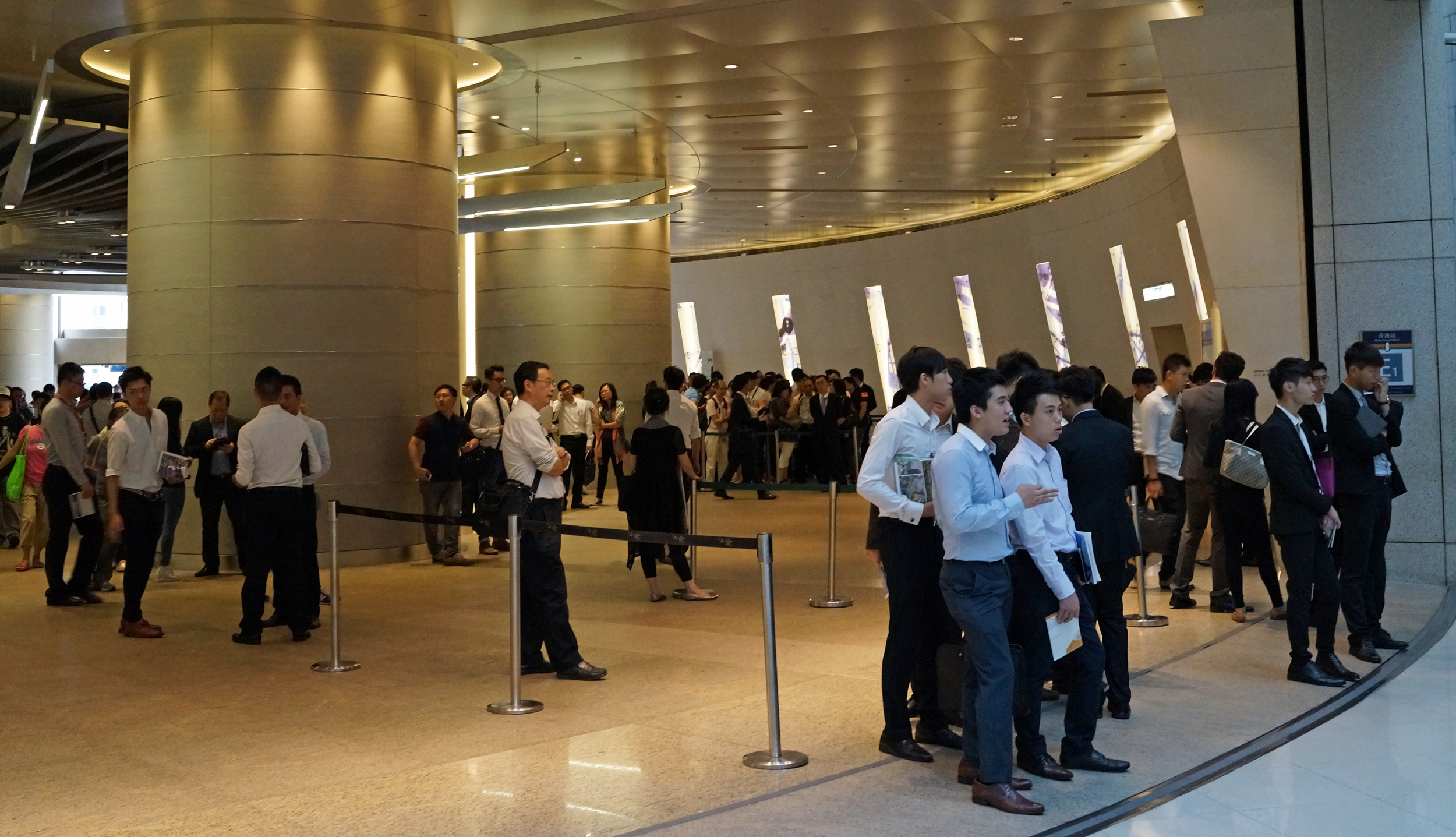 Like a swarm of locusts, young property agents wait for potential clients to come out of IFC Mall (one of our finest malls) - I wouldn't trust these people as far as I could spit and many of them have not learnt to shave yet.