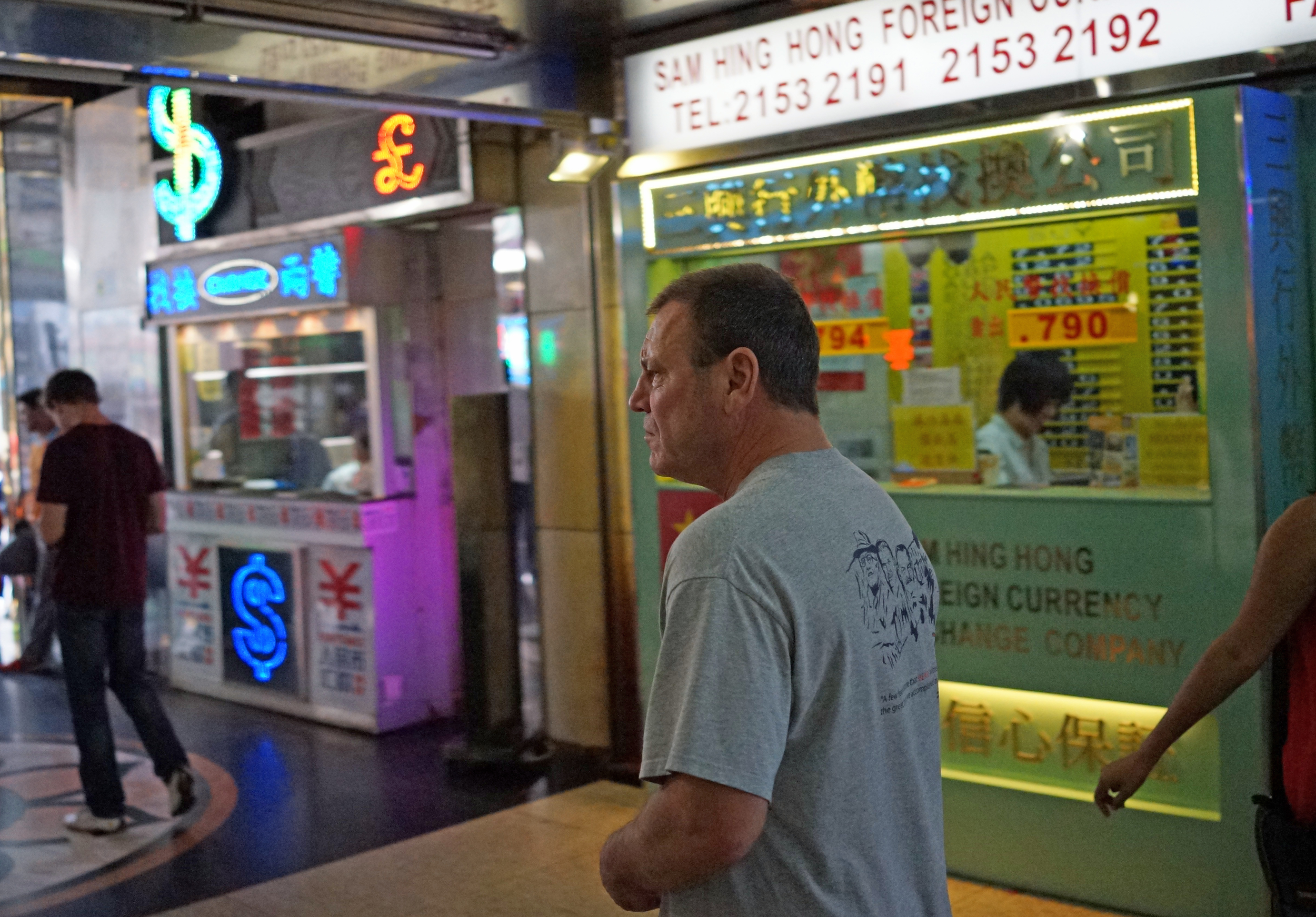 This chap was leaving Chungking Mansions which is perhaps Hong Kong's dodgiest building but it is however the best place in Hong Kong to change money.