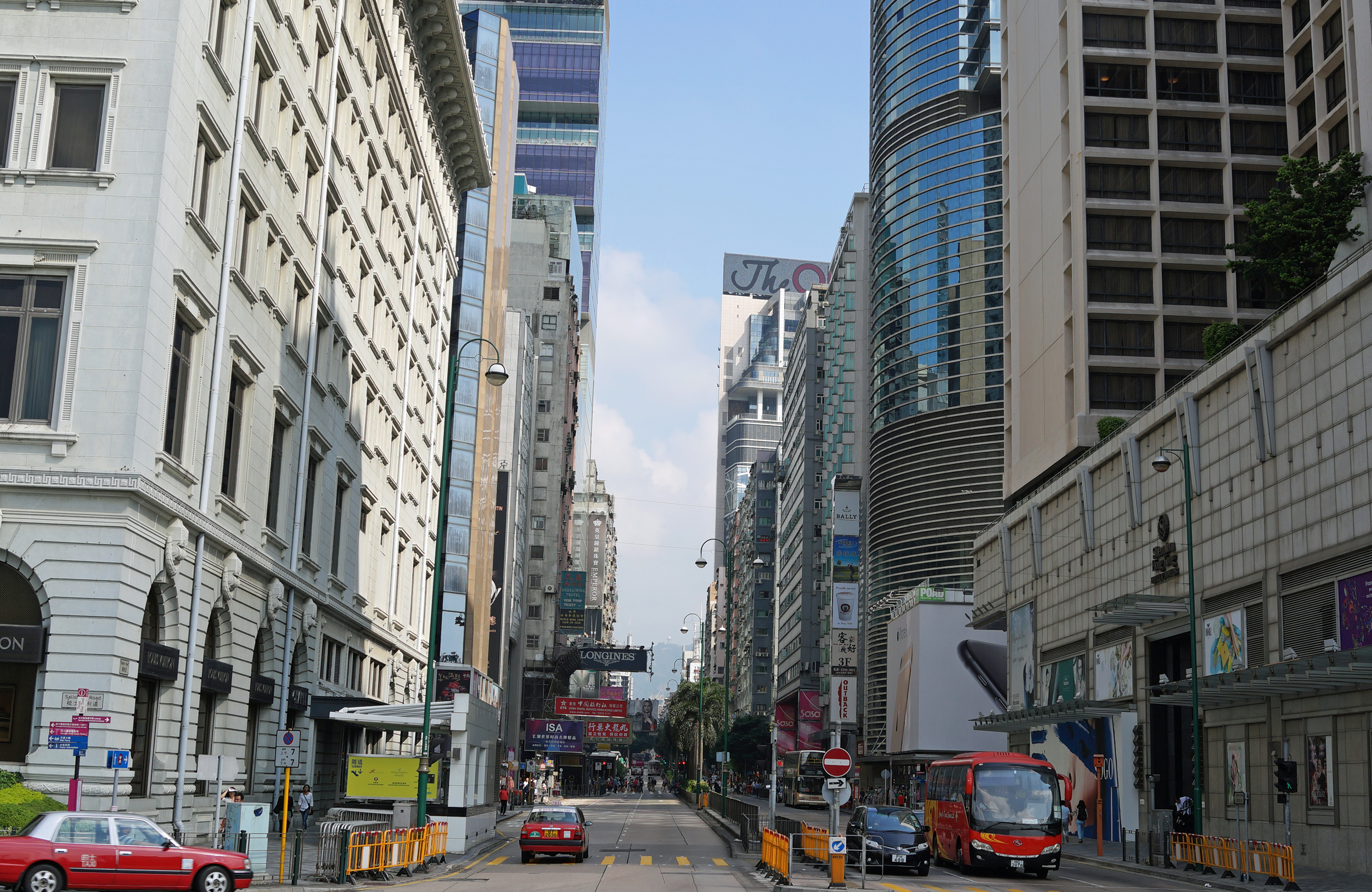 The Peninsula Hotel on the left, the Sheraton Hotel on the right - this is the start of Nathan Road in TST, Kowloon. 2 miles of non stop shopping