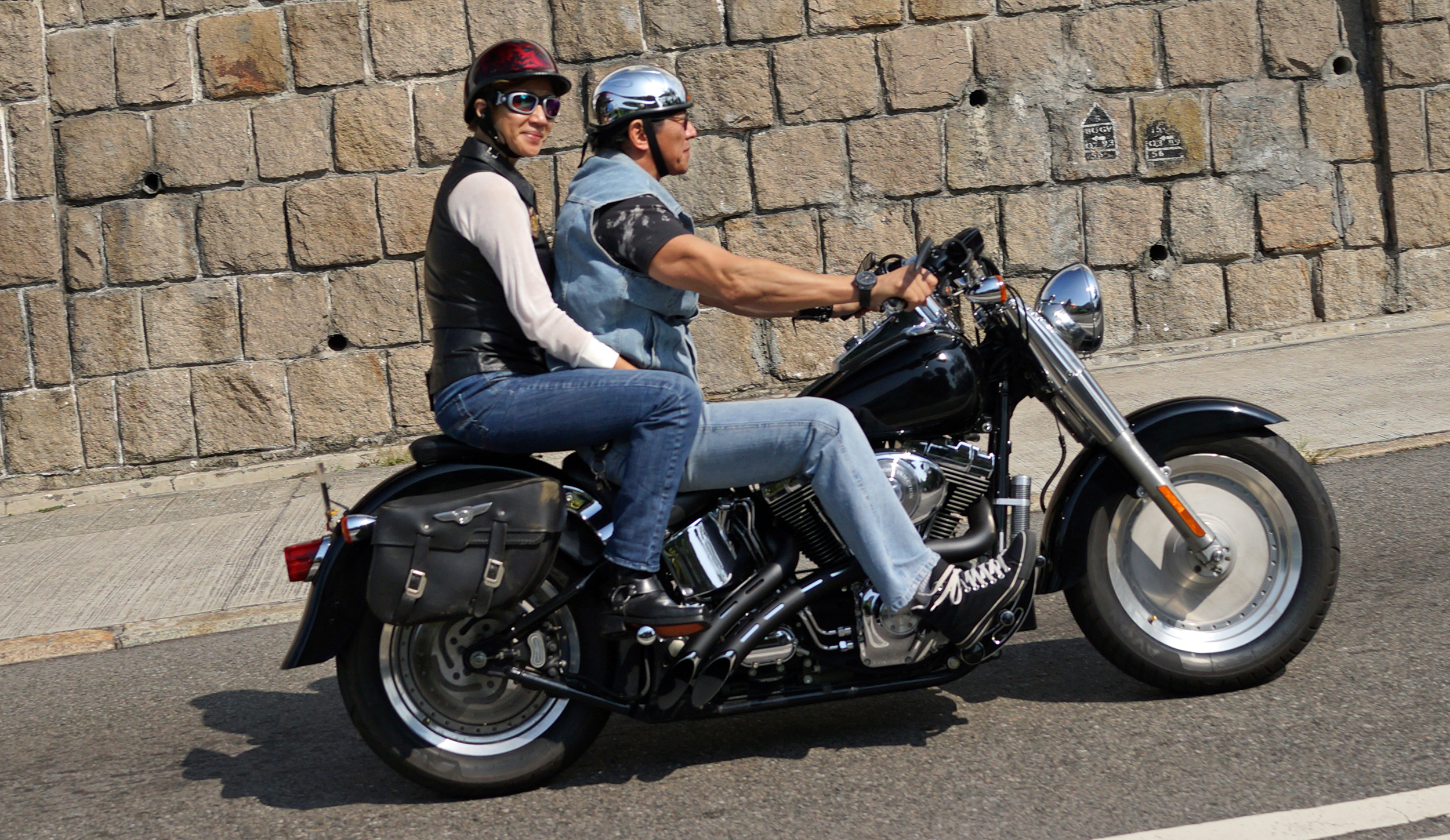 A cool biker chick on a cool Harley -