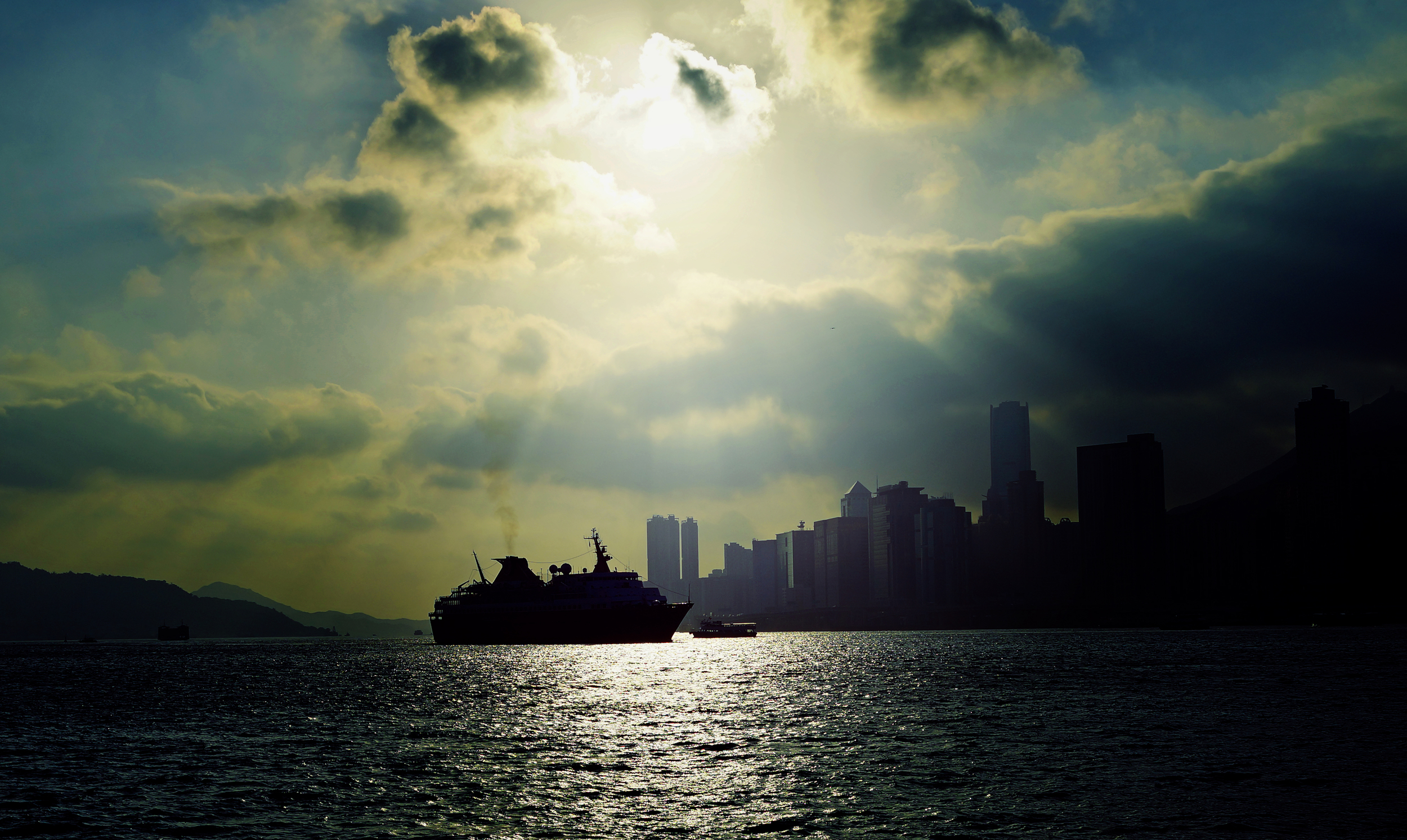 """I am not often in Hung Hom, Kowloon at 8am so it was nice to get an """"almost"""" sunrise image showing one of our 8 gambling ships returning to Hong Kong."""