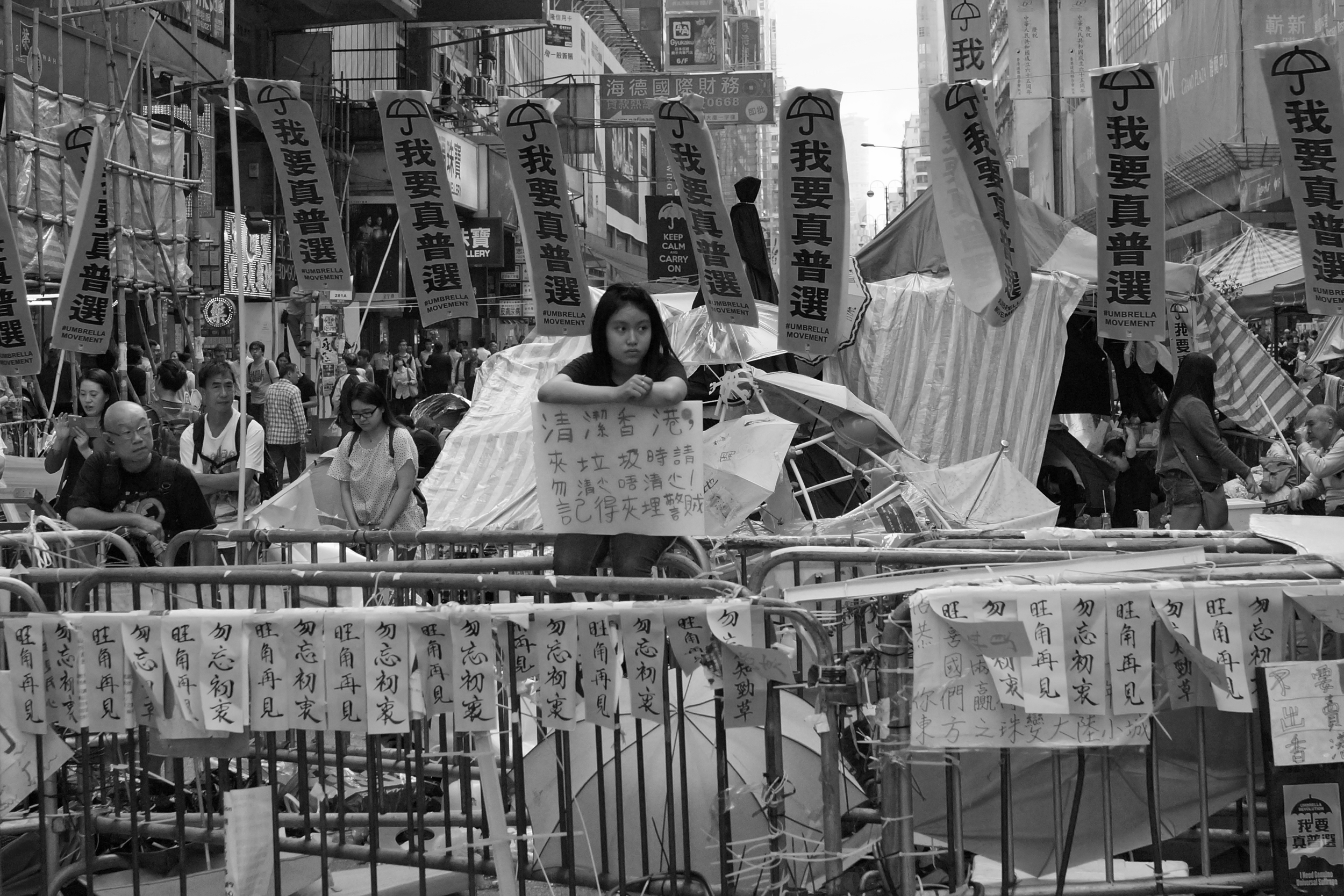 The young lady belongs in a library - image taken 25th November as the battle to clear the streets in Mong Kok starts.. the so called peaceful protesters are reacting violently (as they have done since day one) and it is time our Government dealt with this stupid protest decisively.