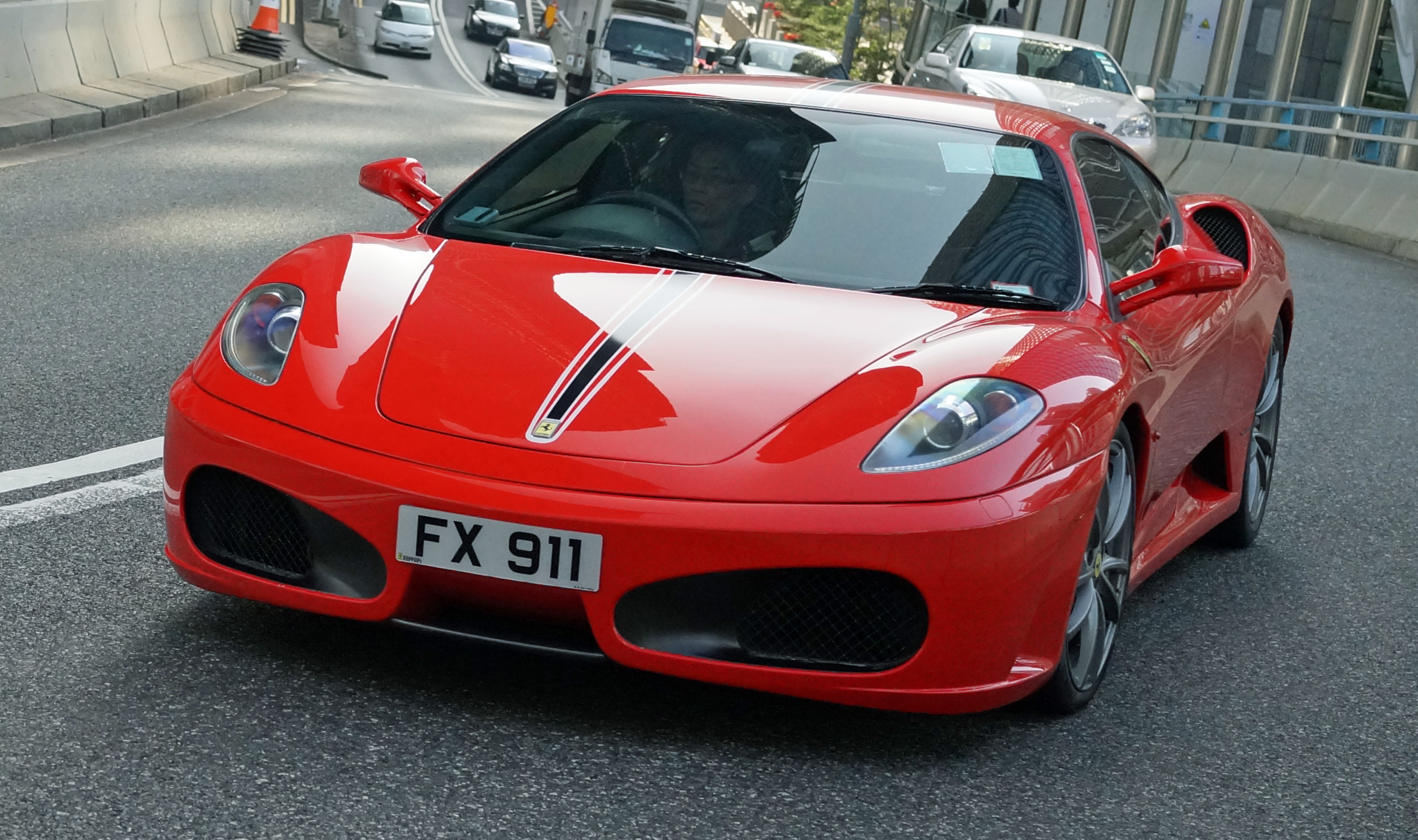 Ferrari, a somewhat legendary car and I love them but in Hong Kong they just seem to be too common and there is something inherently wrong with a 4 year old child strapped in the front seat!! (a common sight here)