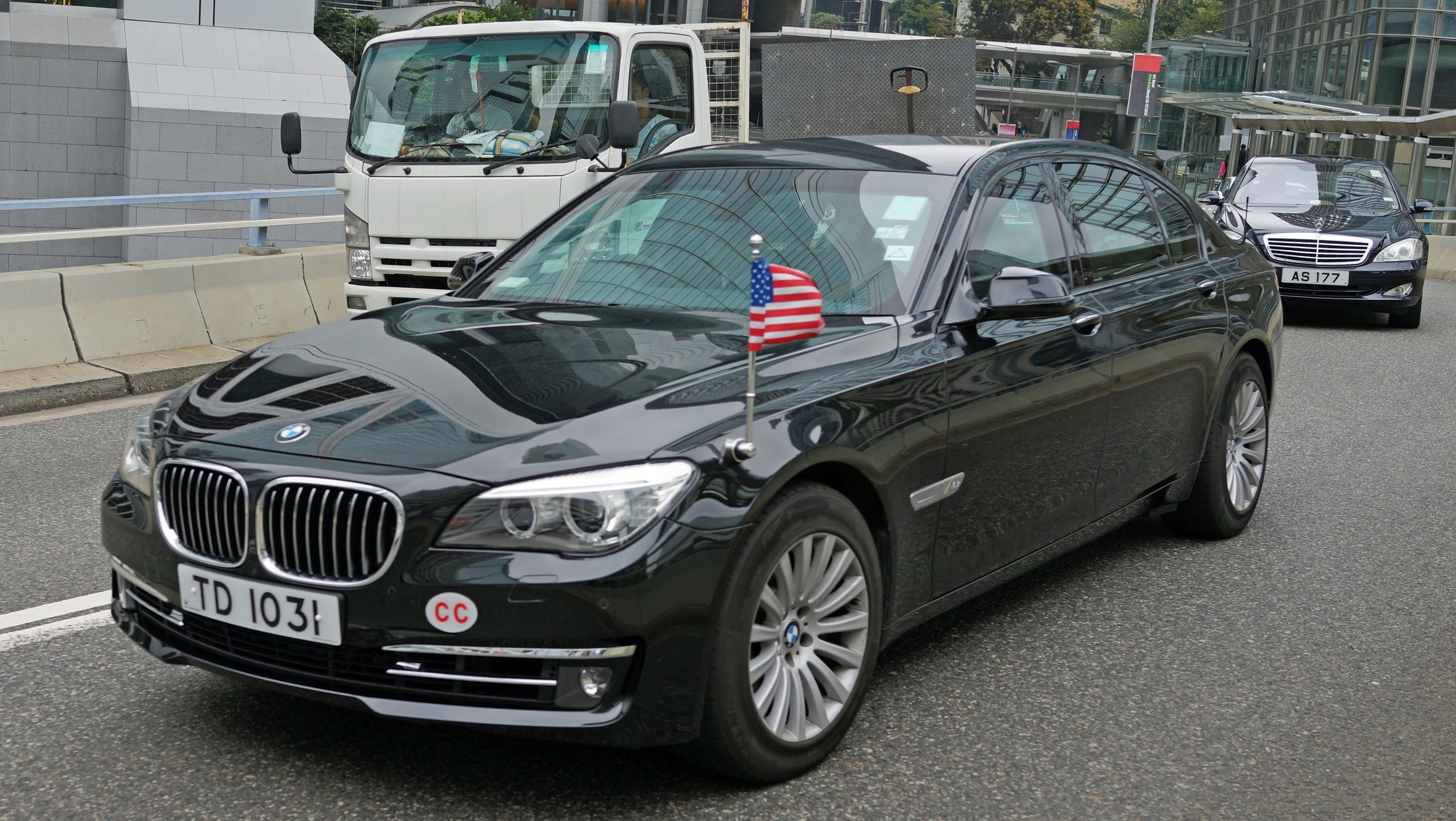 .... felt obliged to show the official car of the US Consul General flying the flag - what is a mystery is why the US Consulate use BMW's and Lexus's, surely it is time that they stuck the flag on a Tesla the all electric US built super car....